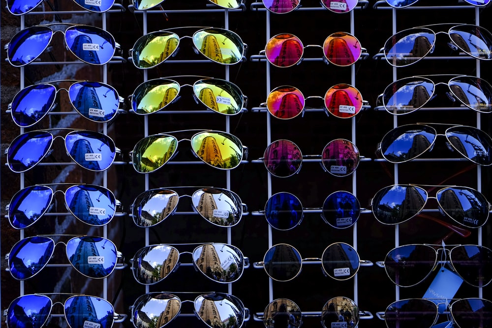 photo of assorted-color-and-design sunglasses lot