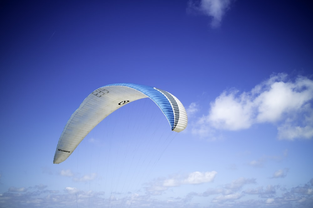 blue and white paraglider