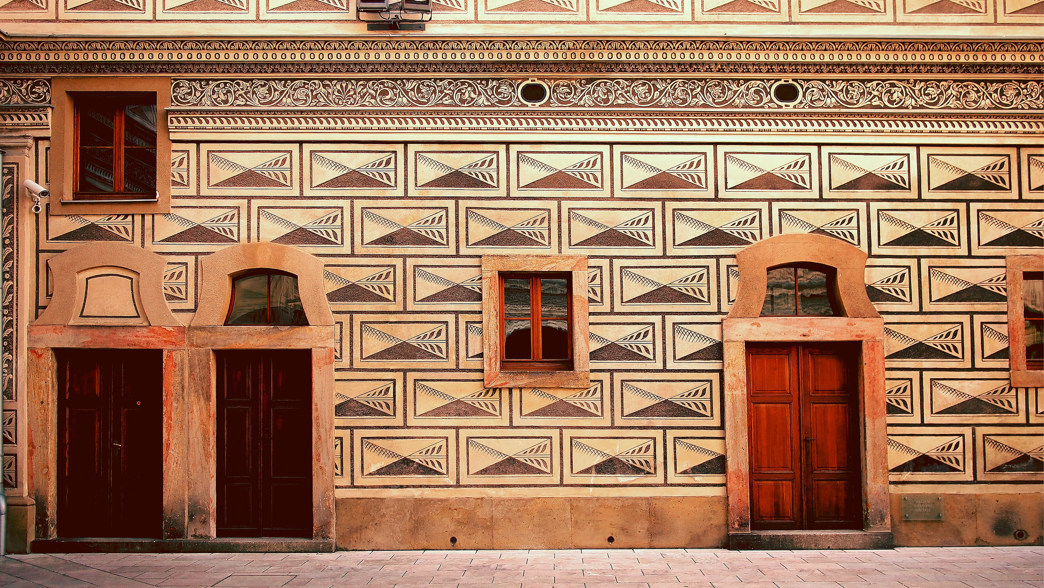 A building in Prague with intricate cultural and geometrical designs.