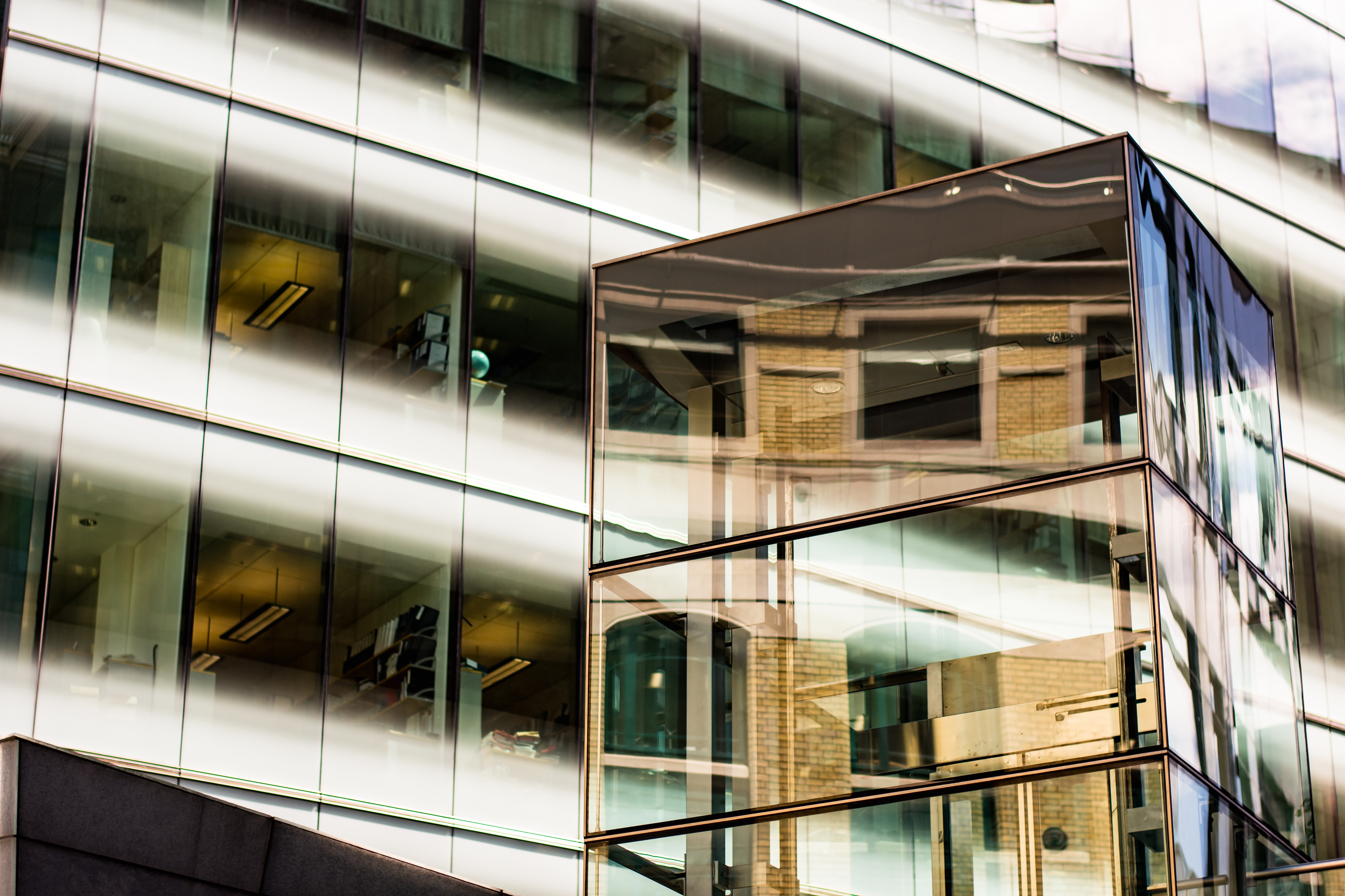 Floor-to-ceiling windows of an office building seen from outside