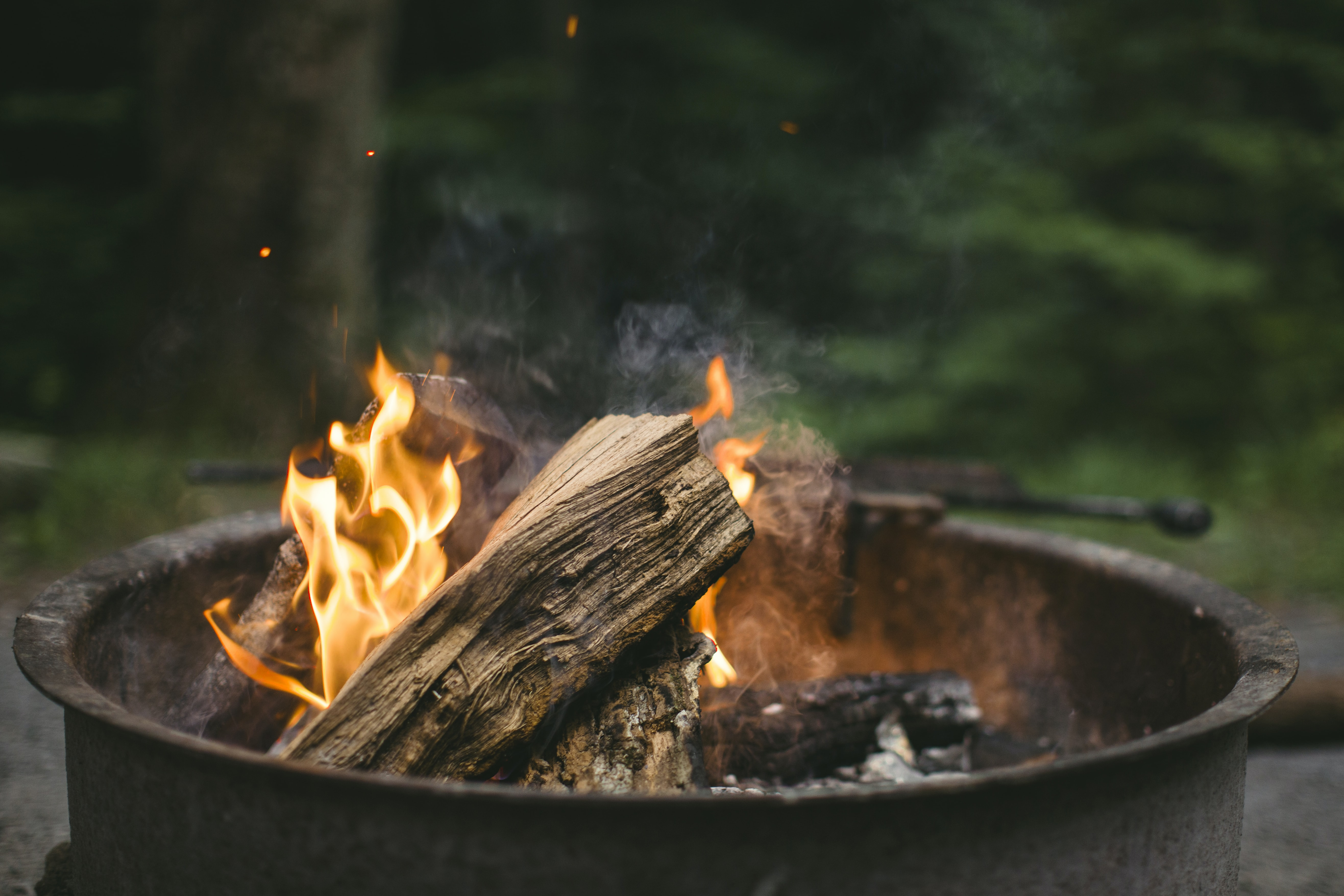 Close-up of burning firewood in a black caldron