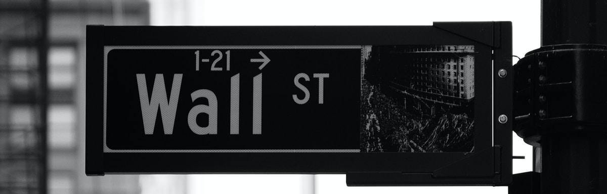 grayscale photo of Wall St. signage