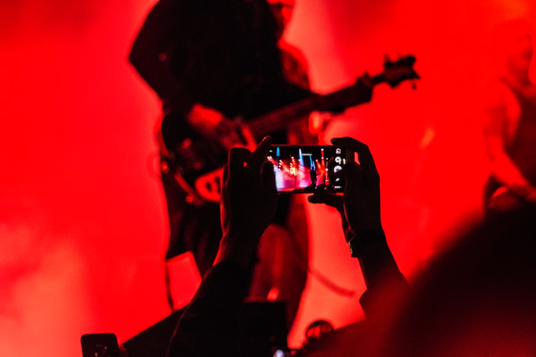 Guitarist bathed in red light
