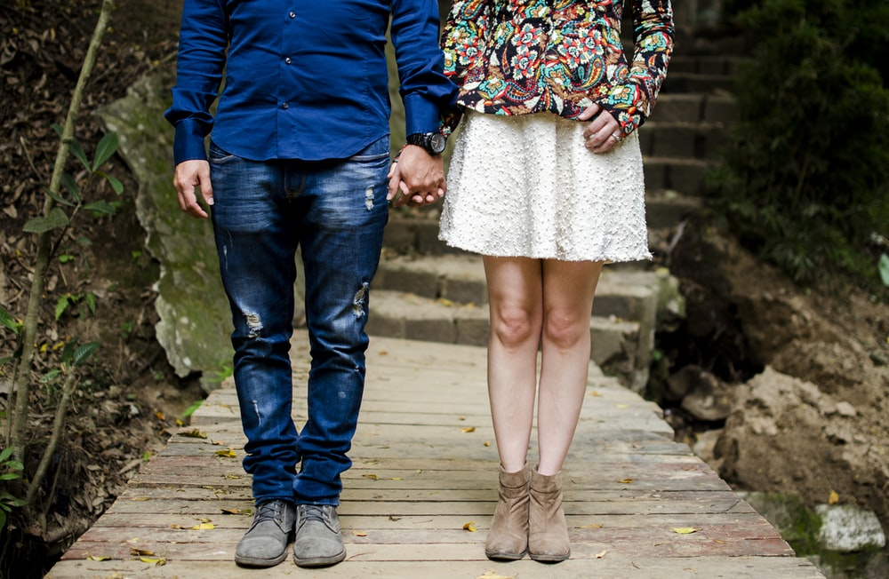 man and woman holding hands during daytime