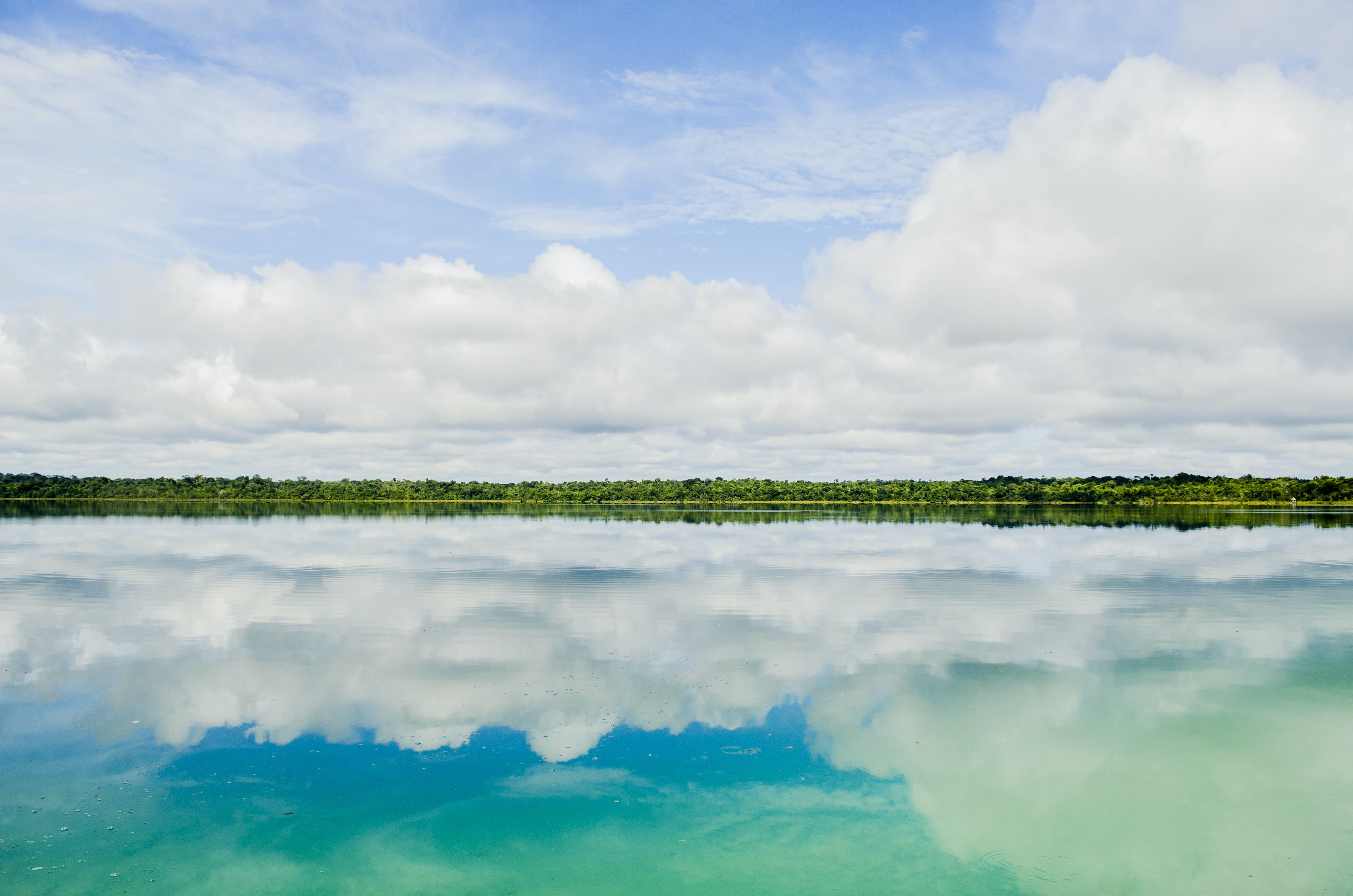 reflection of clouds in body of water