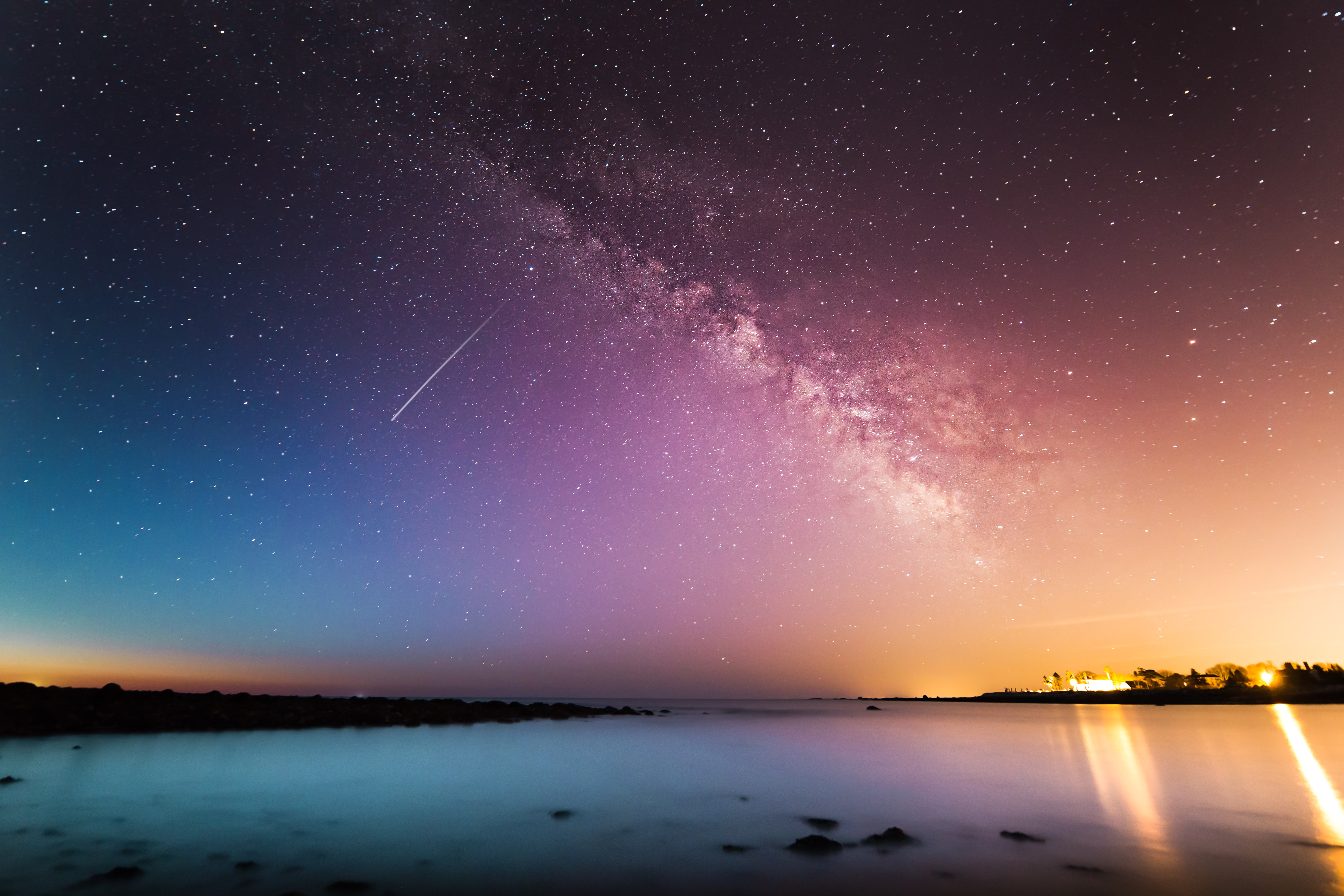 Colorful starry night sky with the Milky Way and a shooting star over Rye