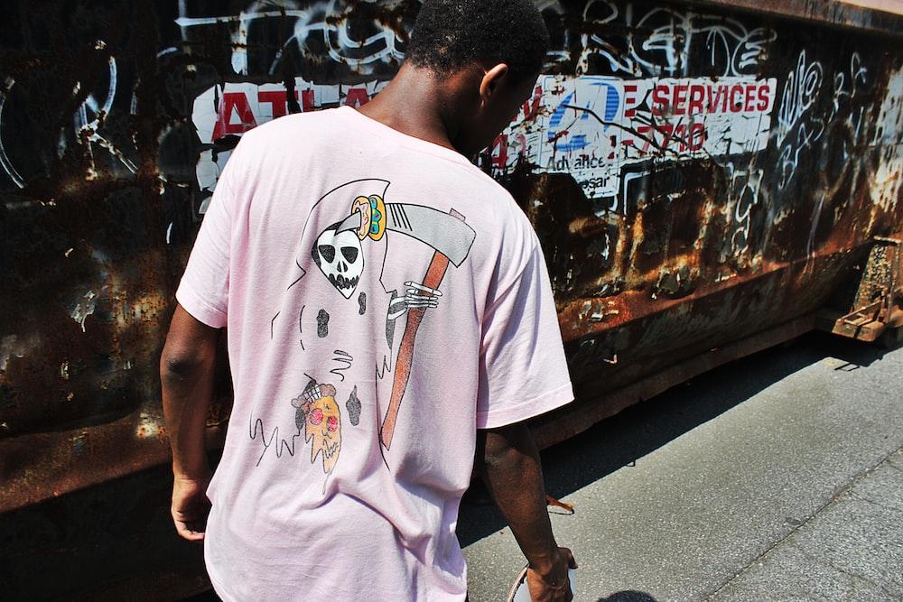 man wearing pink crew-neck shirt