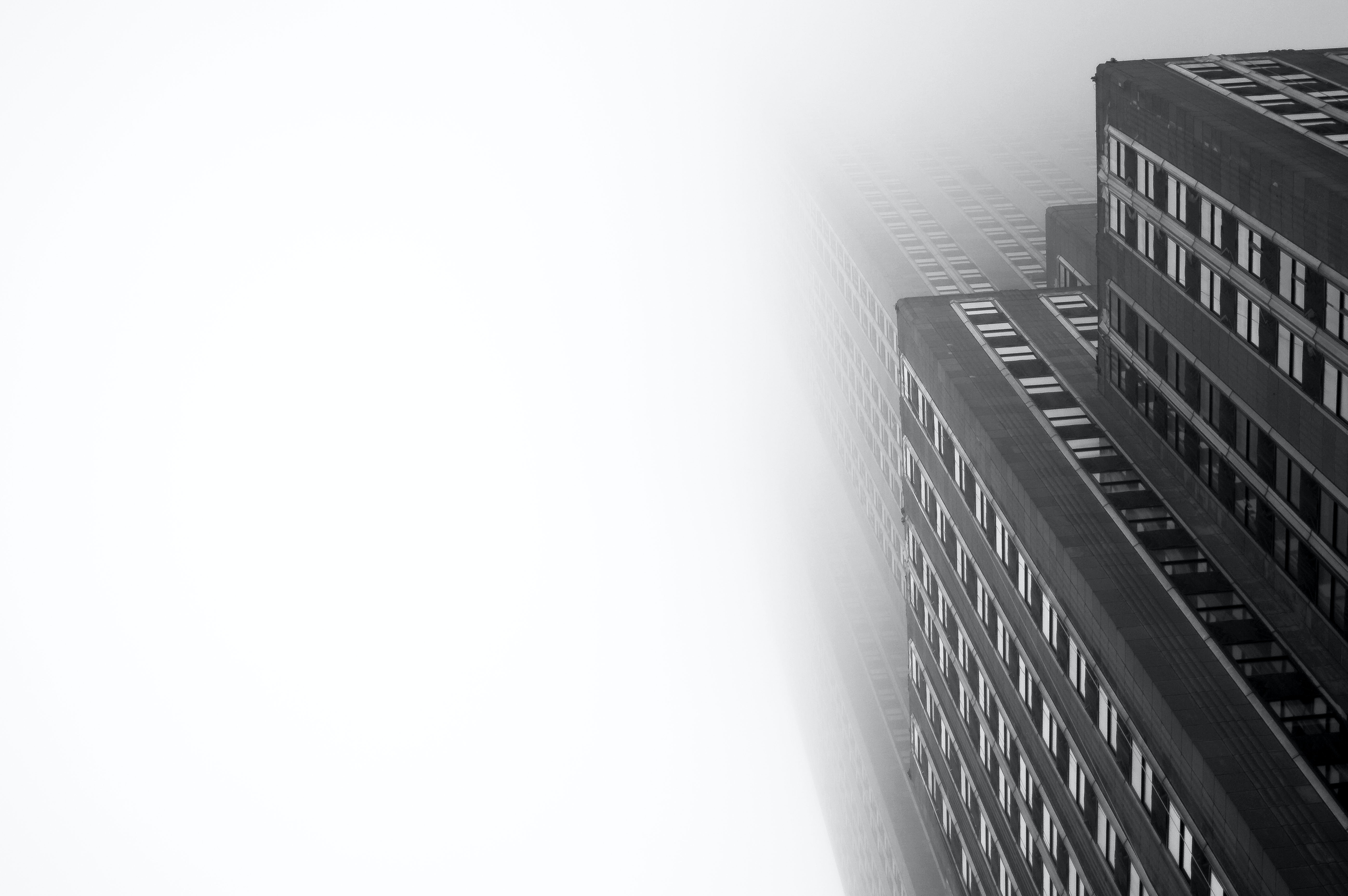 The towering Empire State Building shrouded in thick fog