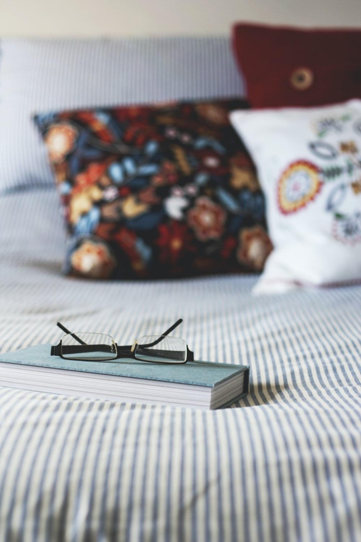 eyeglasses on book