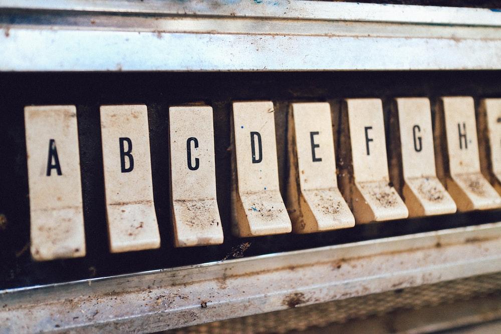 close up photography of brown jukebox letter keys