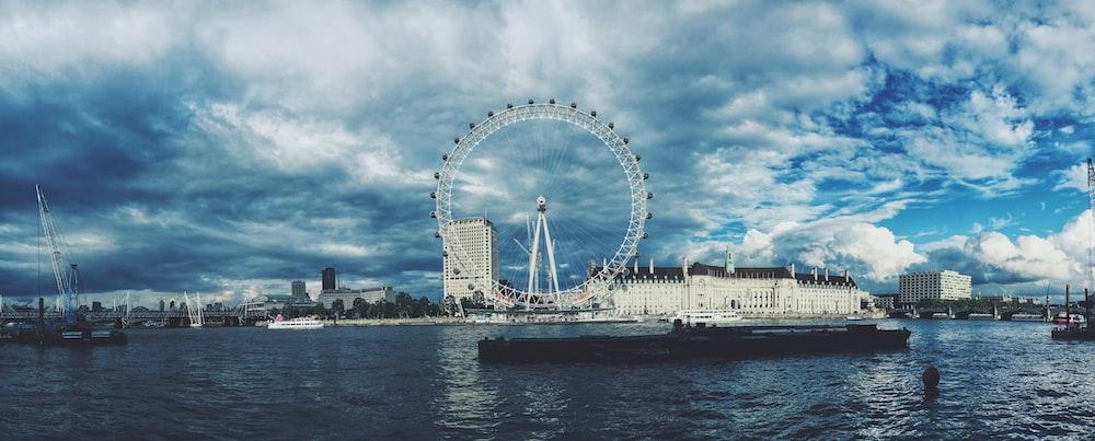 skyline photography of London Eye under white cloudy sky at daytime