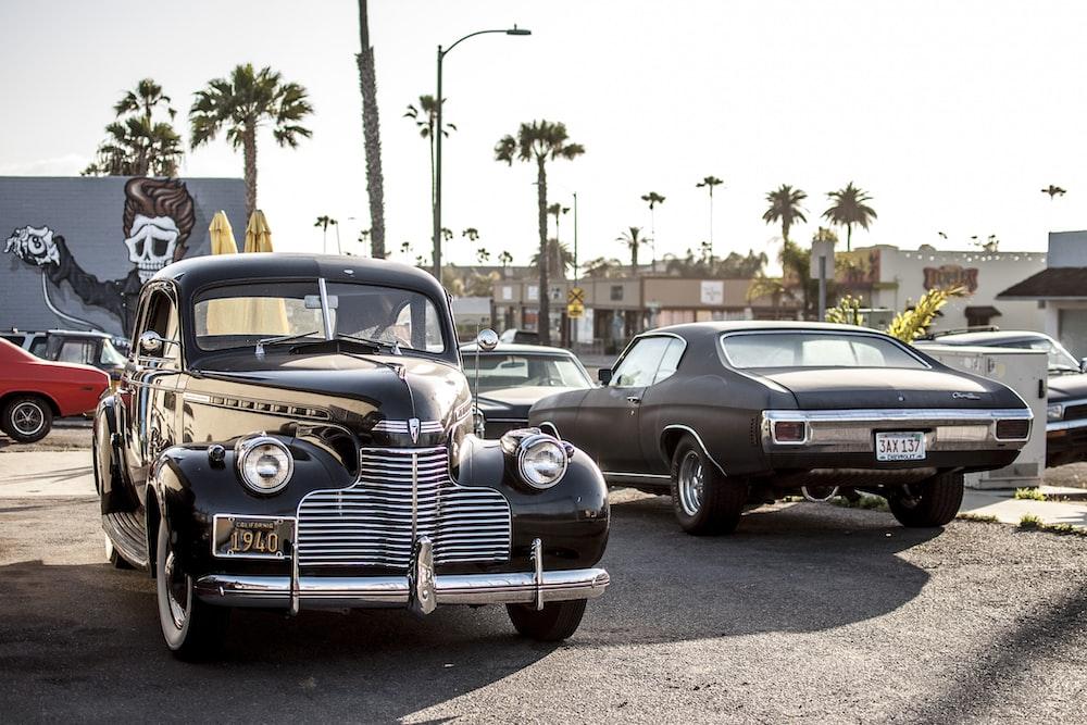 black car beside car during daytime