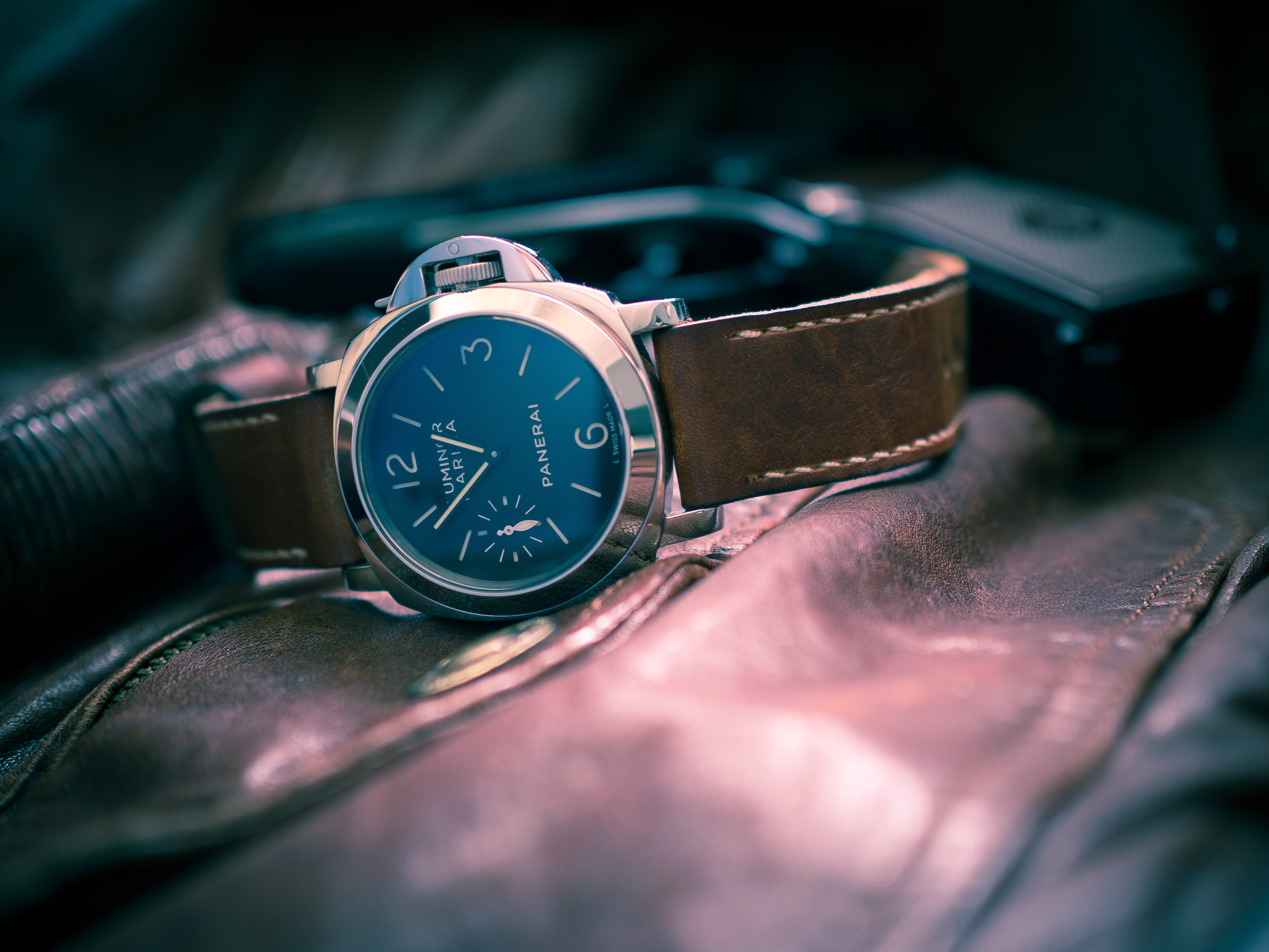 selective-focus photography of black chronograph watch