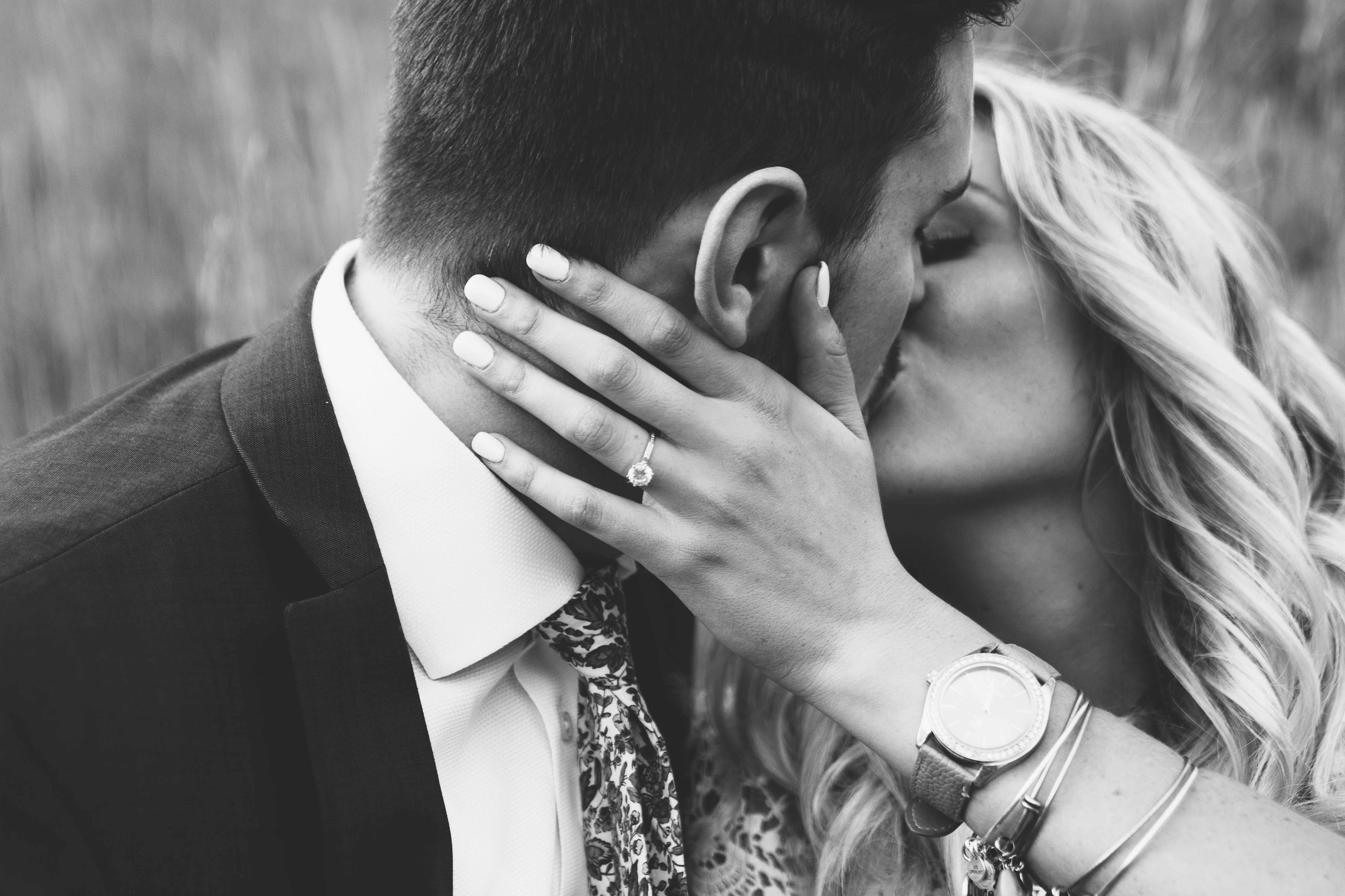 Woman holds a man she's kissing in black and white photo