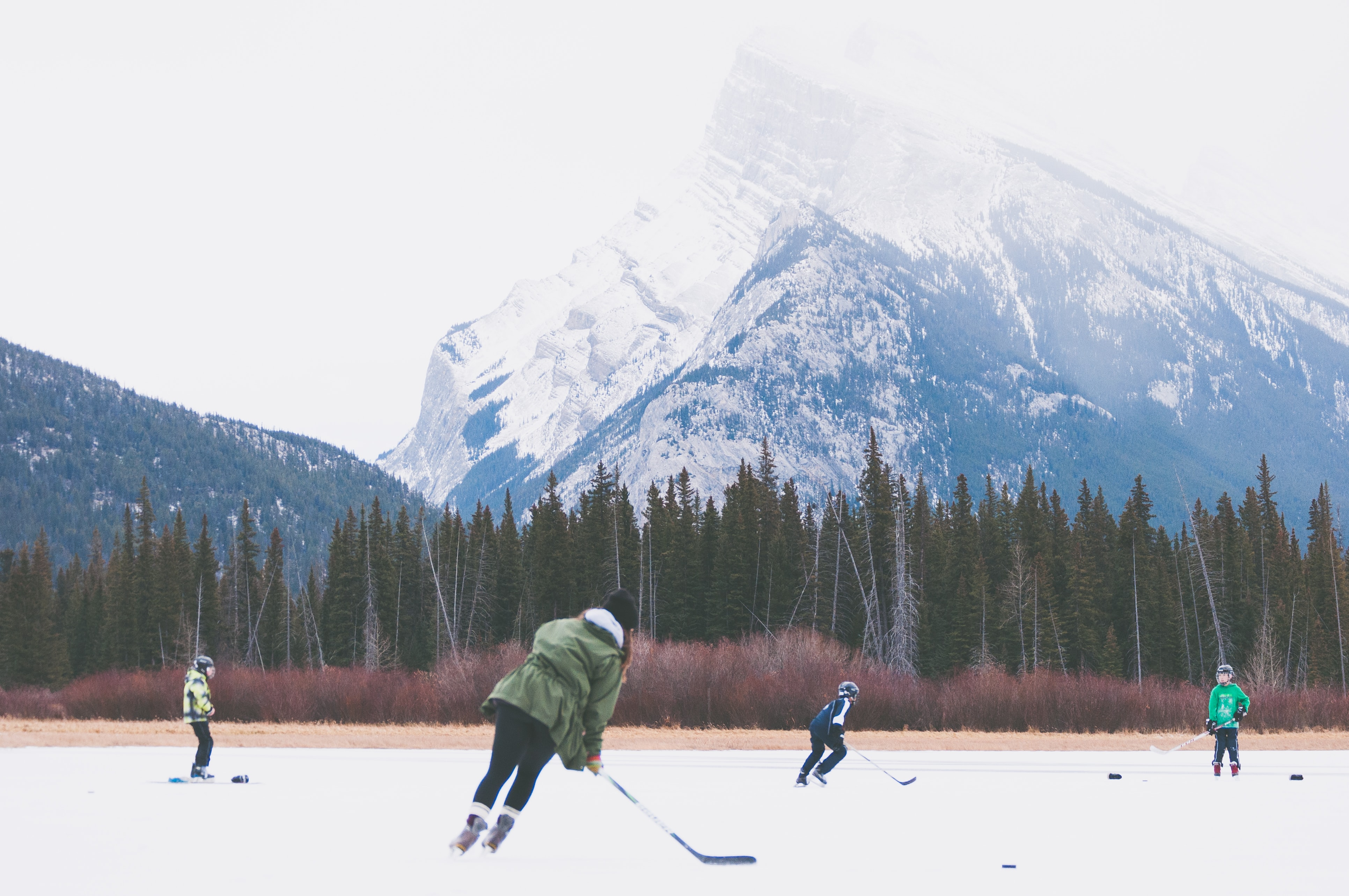 Children playing ice hockey in Banff National Park