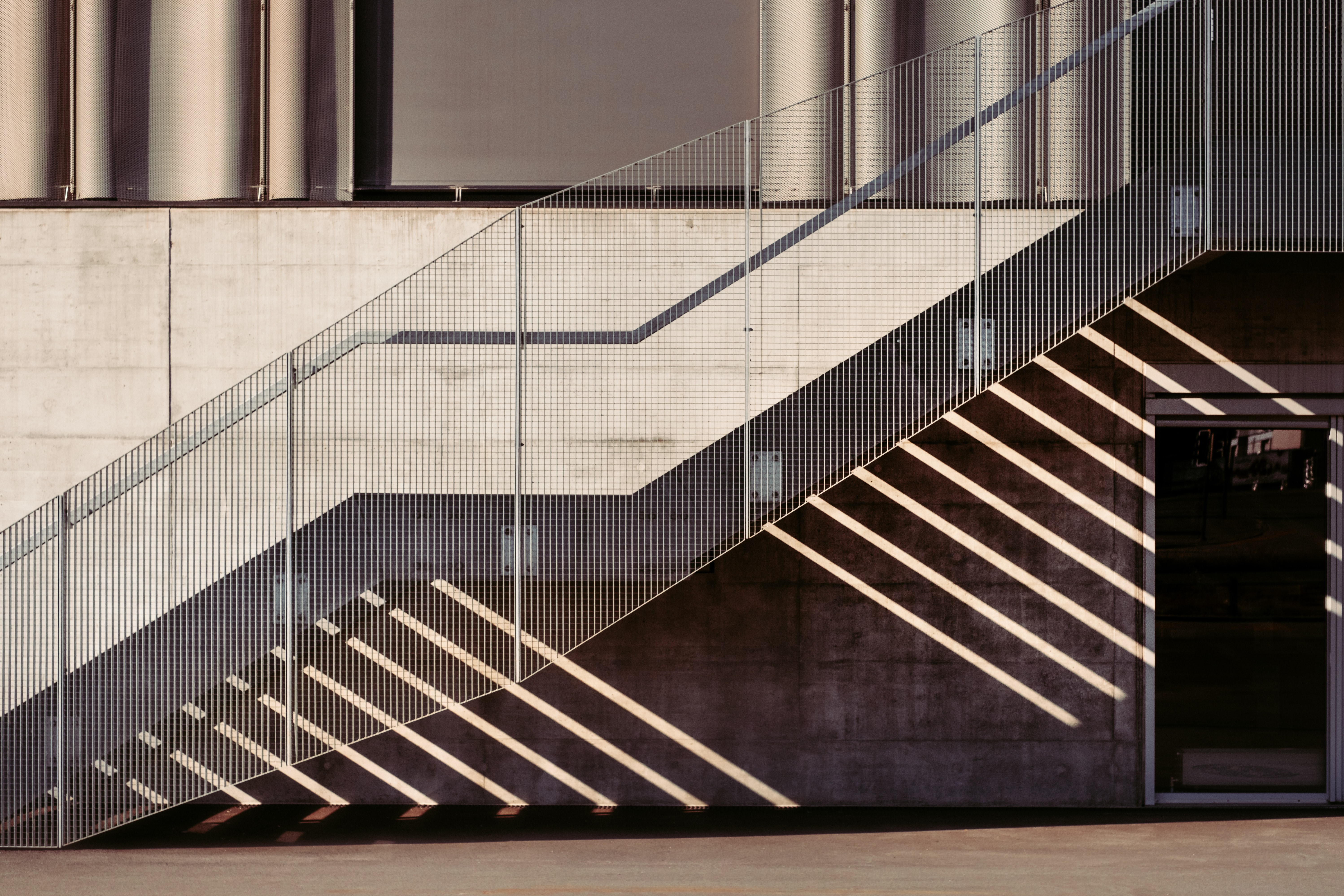 A metal stairway outside a concrete building