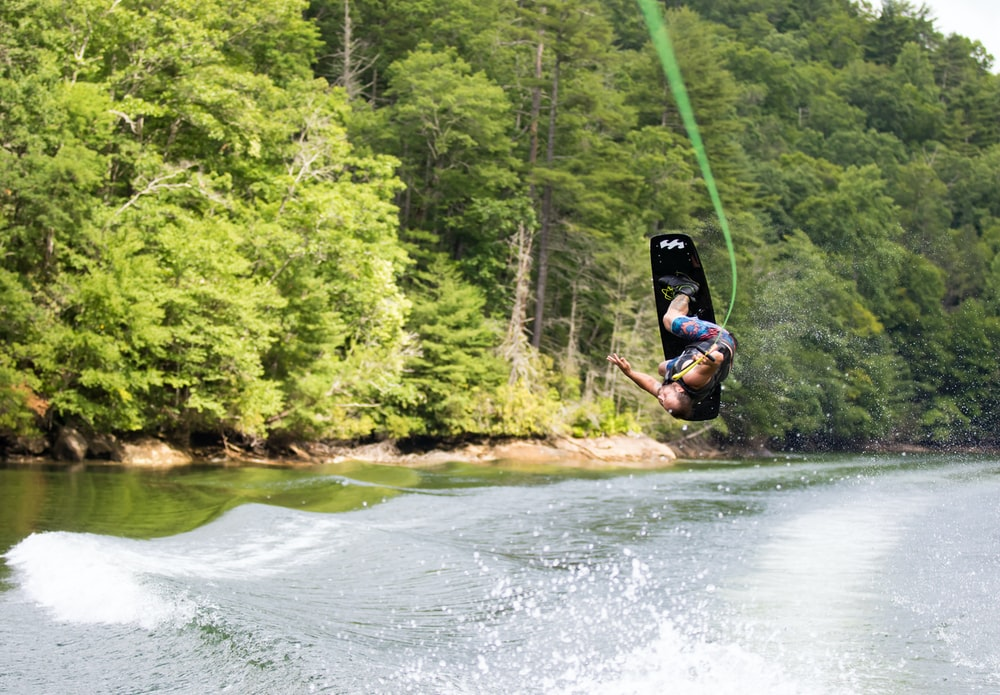 person using water ski during daytime