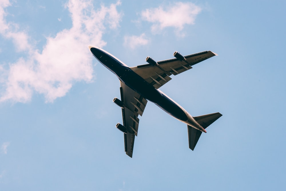 Partial silhouette of a passenger airplane from the ground.