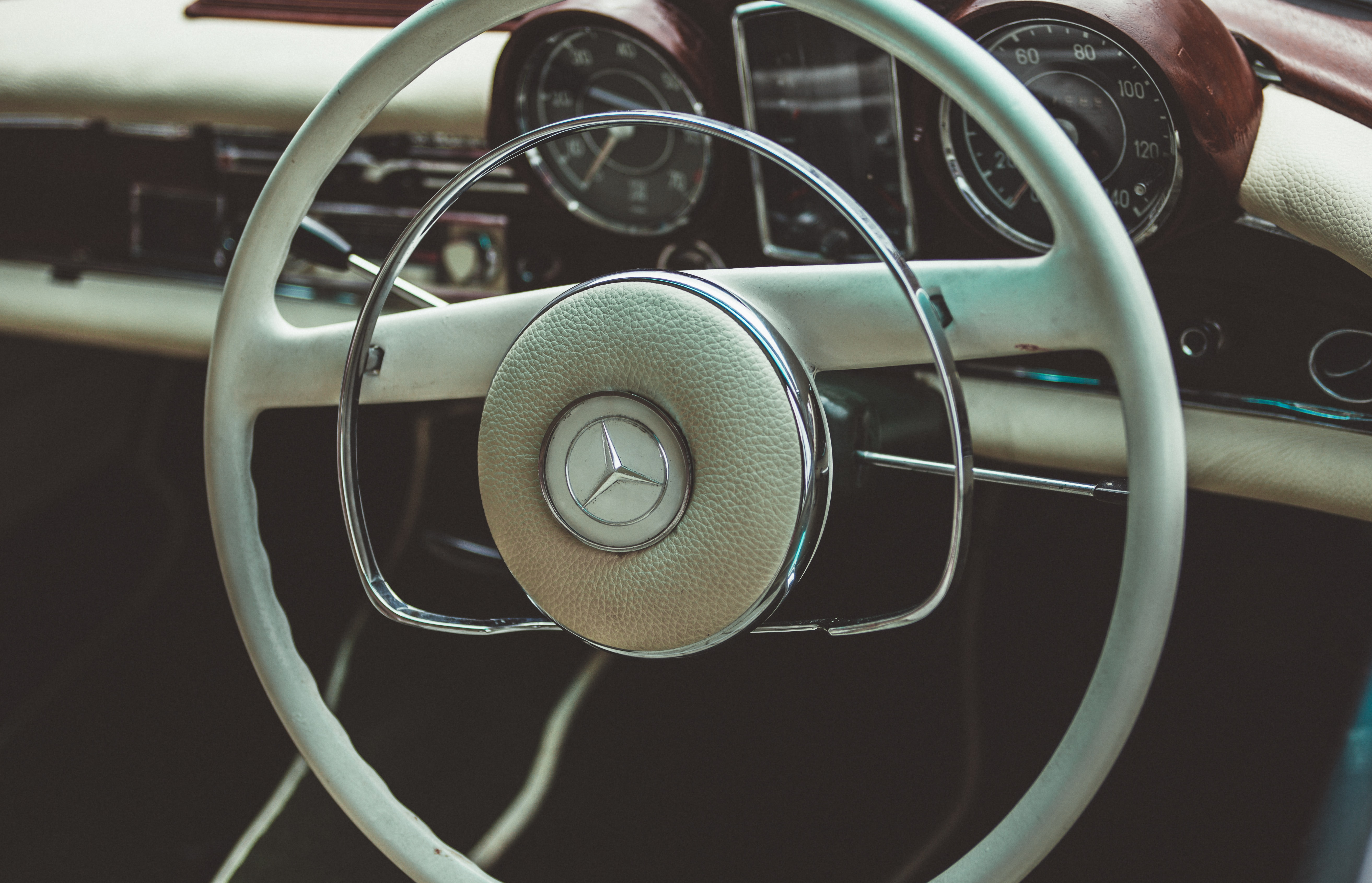 Steering wheel and interior of retro Mercedes Benz.