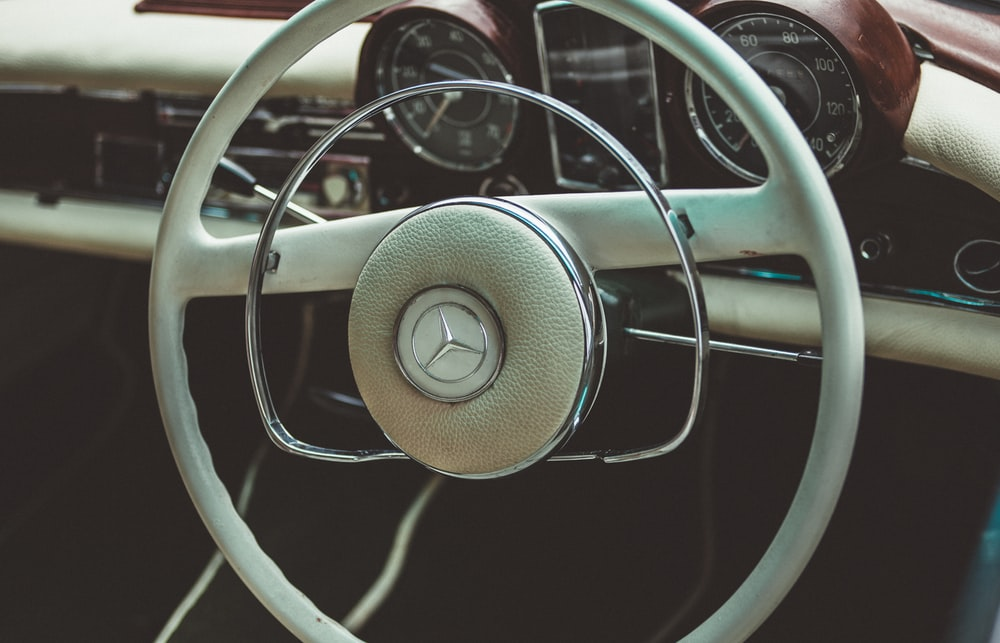 teal Mercedes-Benz vehicle steering wheel