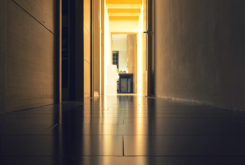 sephia photo of floor tiles between wall