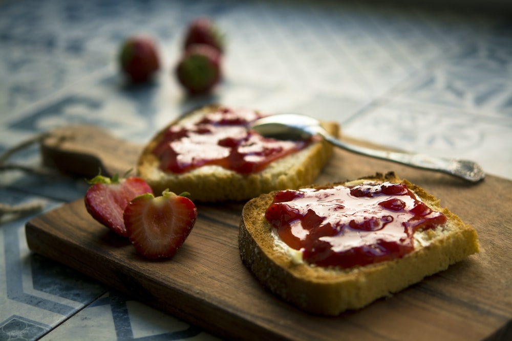 photo of bread with strawberry jam