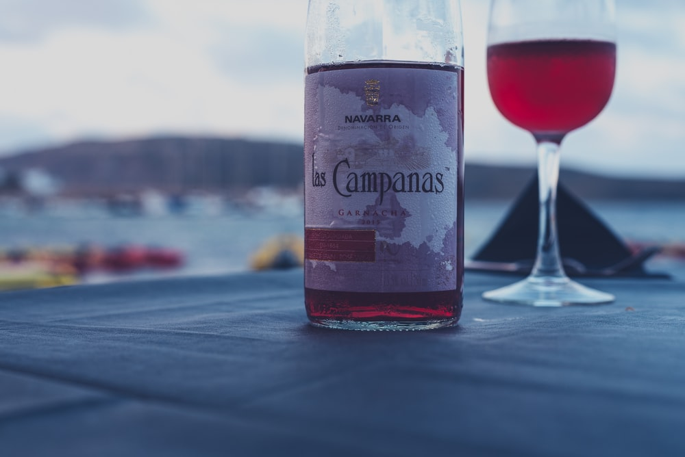 Macro view of a Campanas wine bottle and a wine glass in Fornells