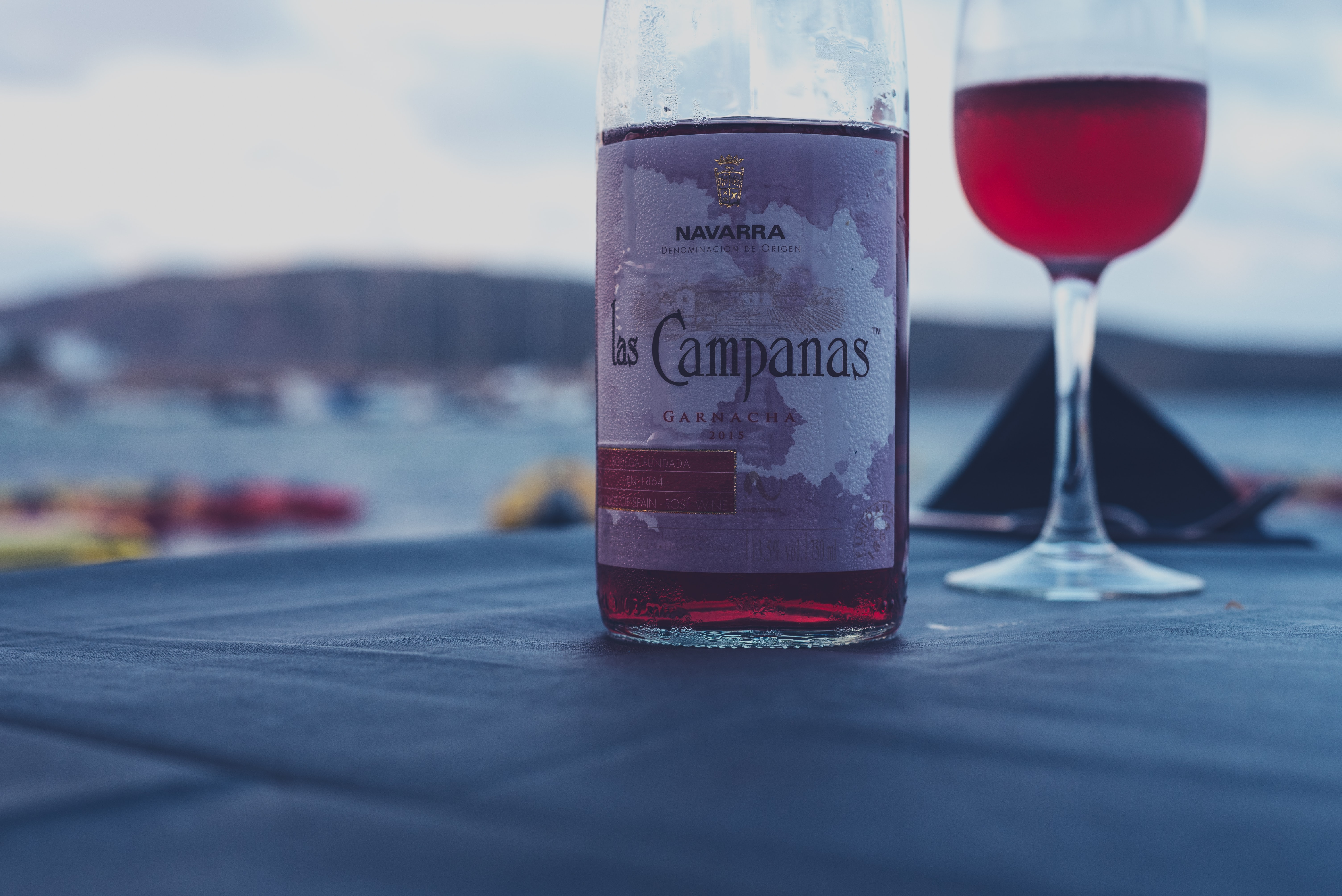 Campanas red wine bottle beside wine glass