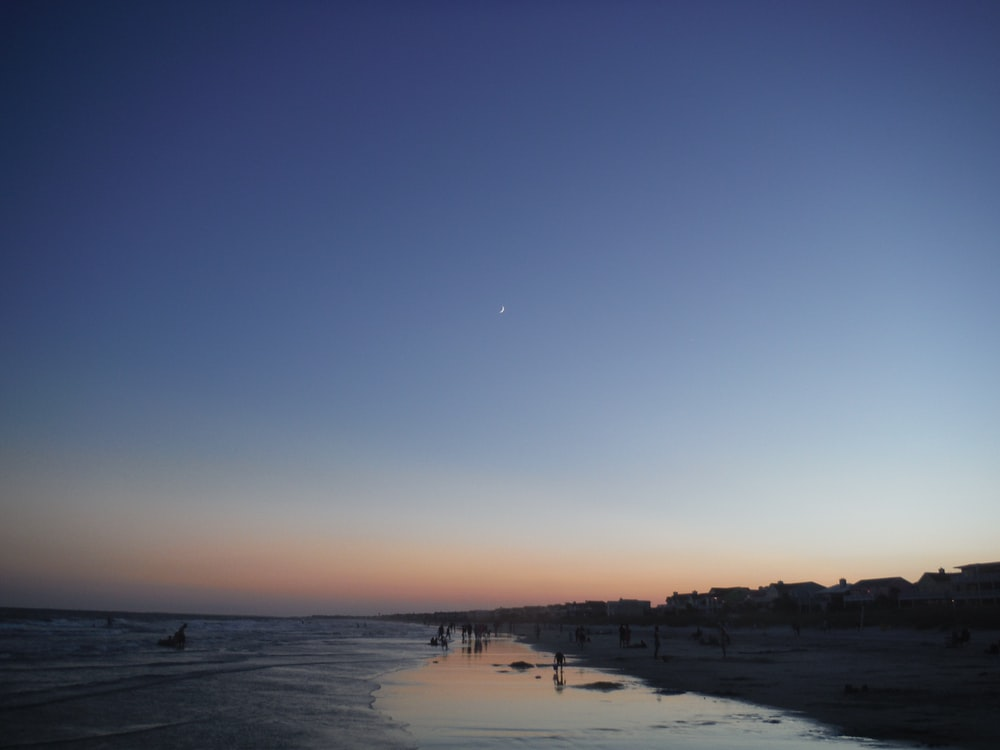 beach with lots of people during dawn
