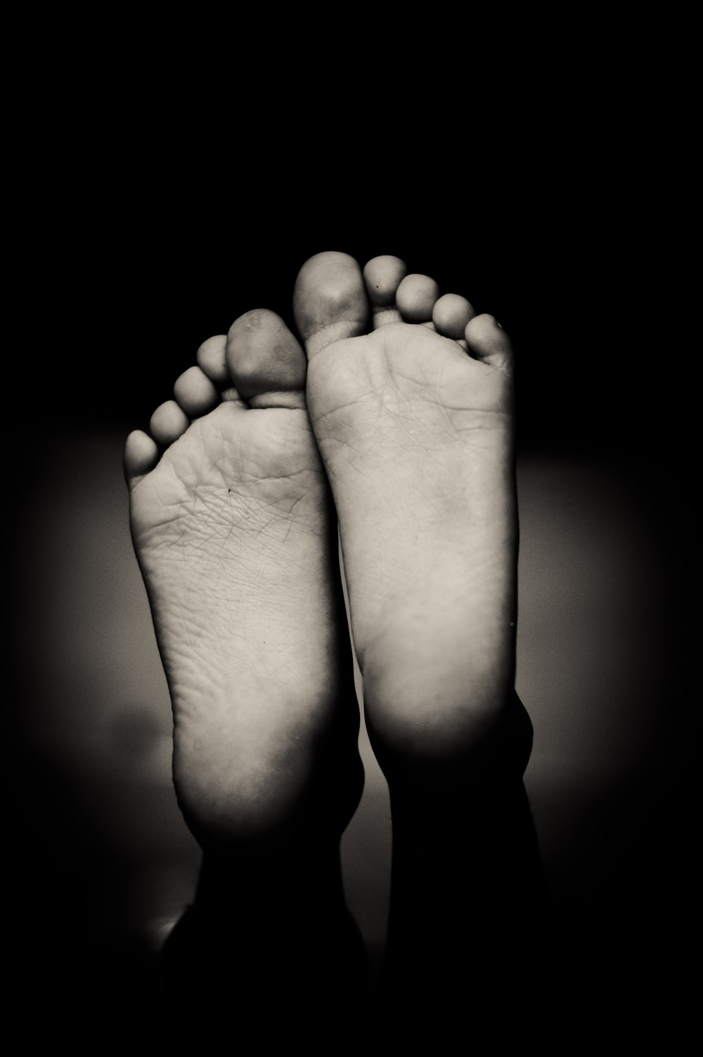 grayscale photo of human feet