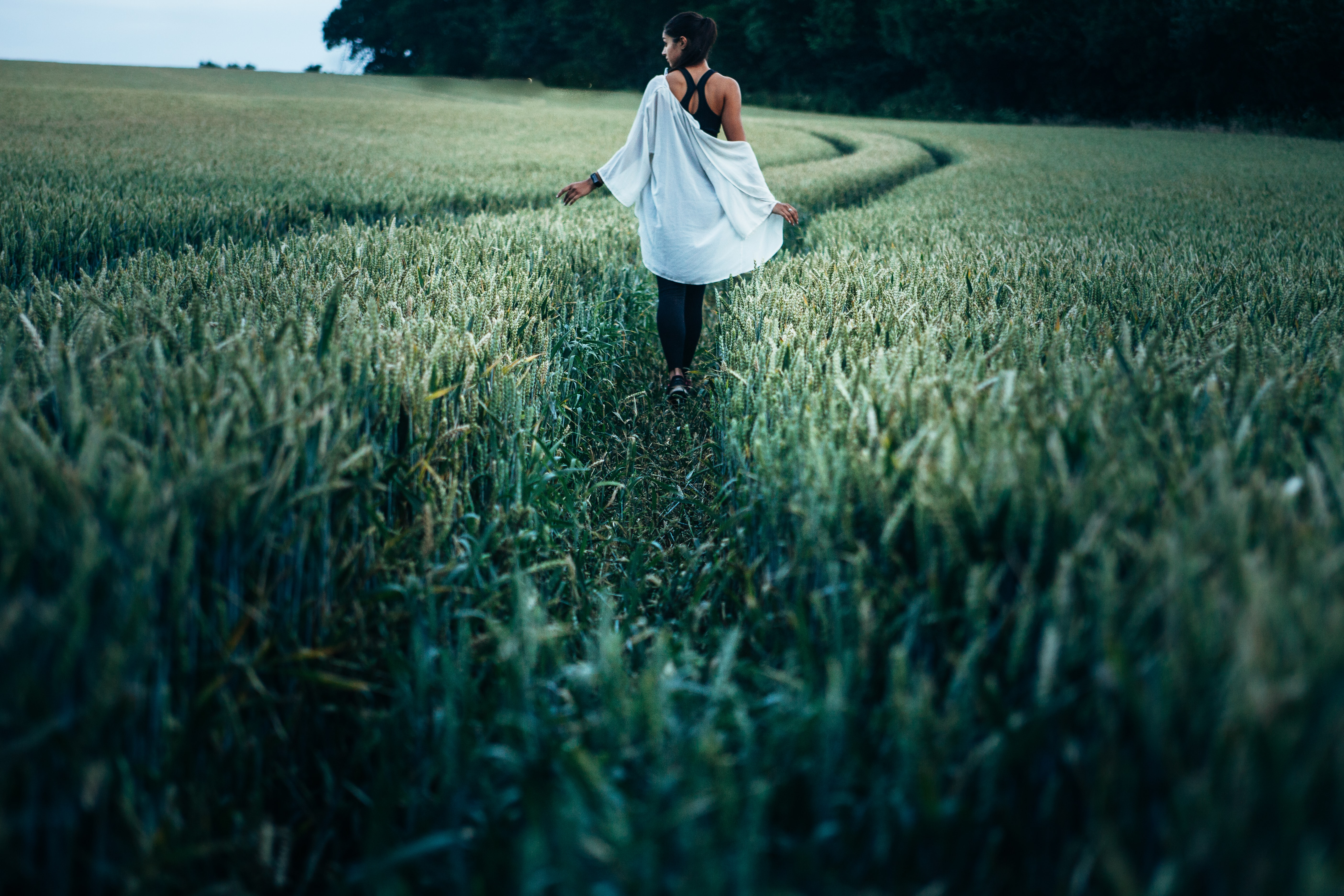 woman walking on grass field