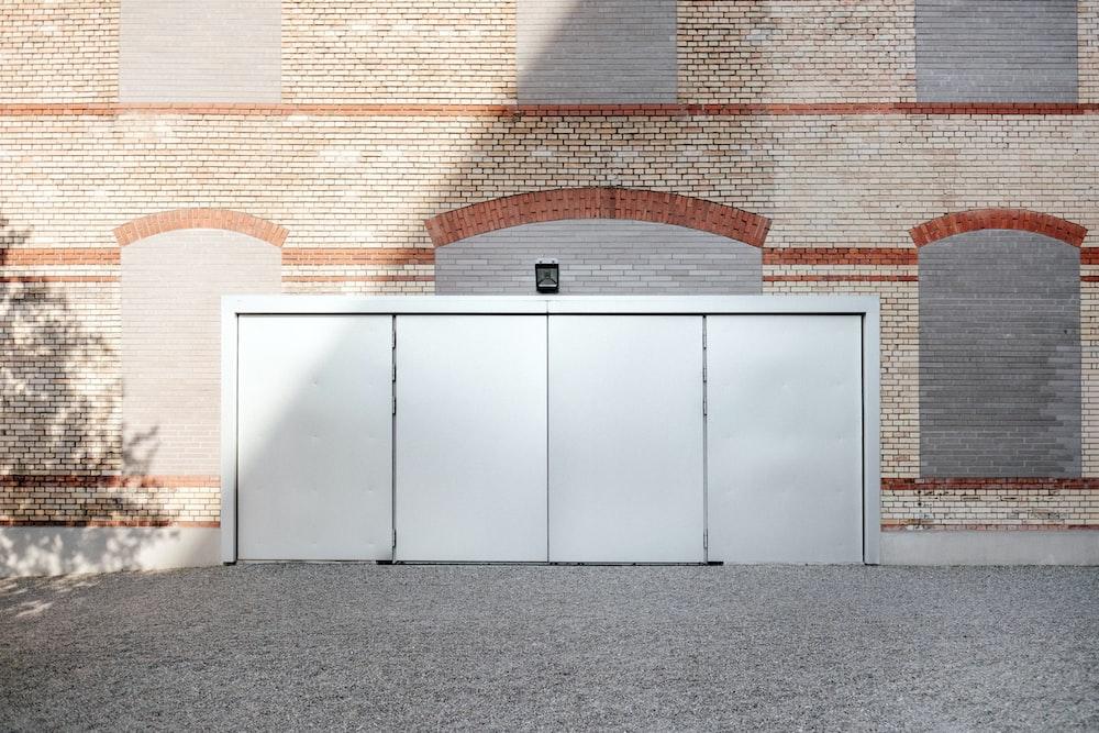 gray metal door under brown building