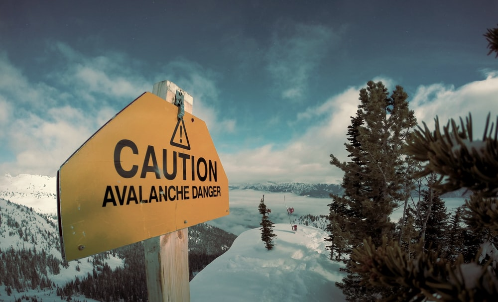 caution avalanche danger signage during winter