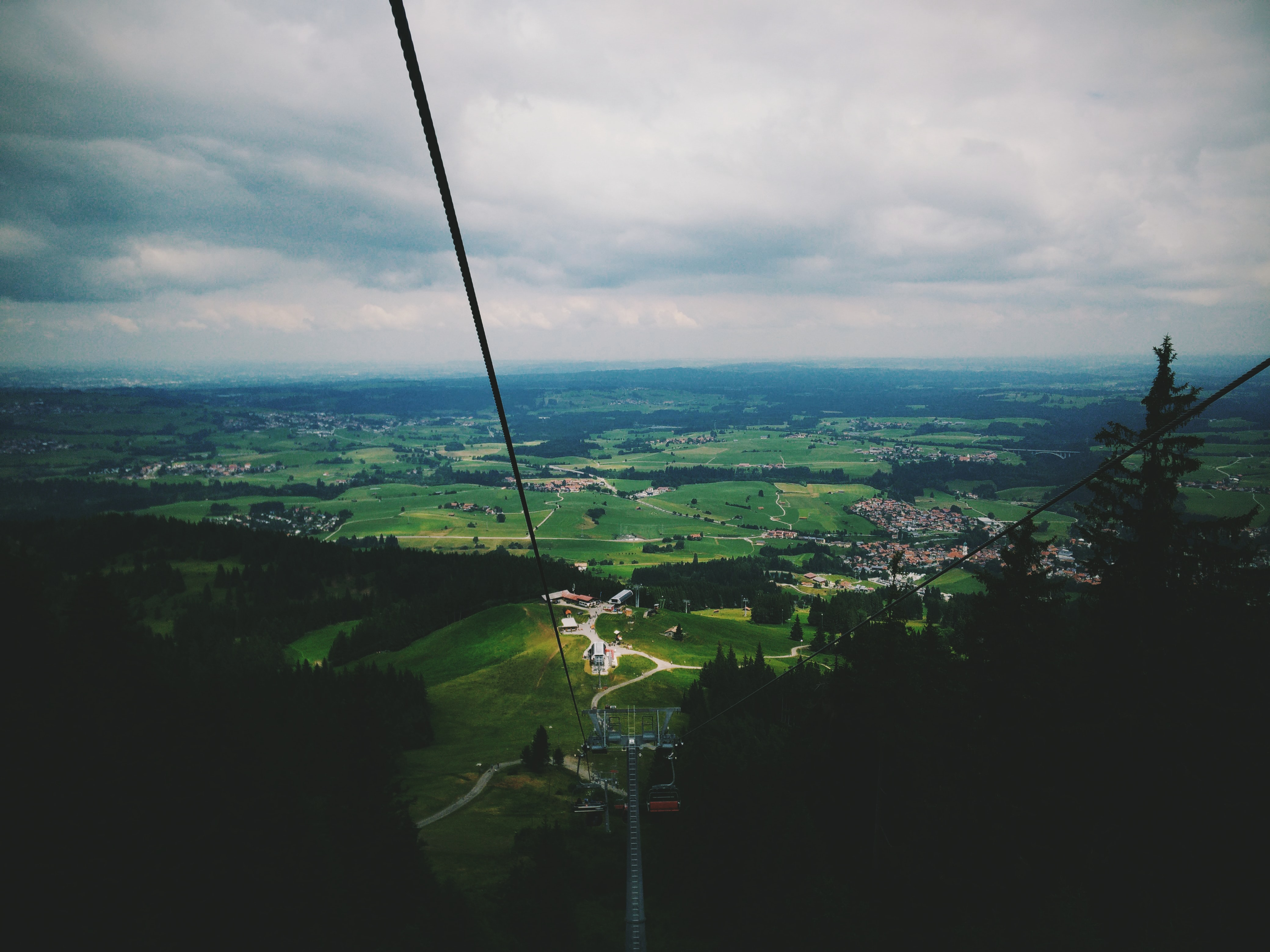 View from a chairlift on green countryside below