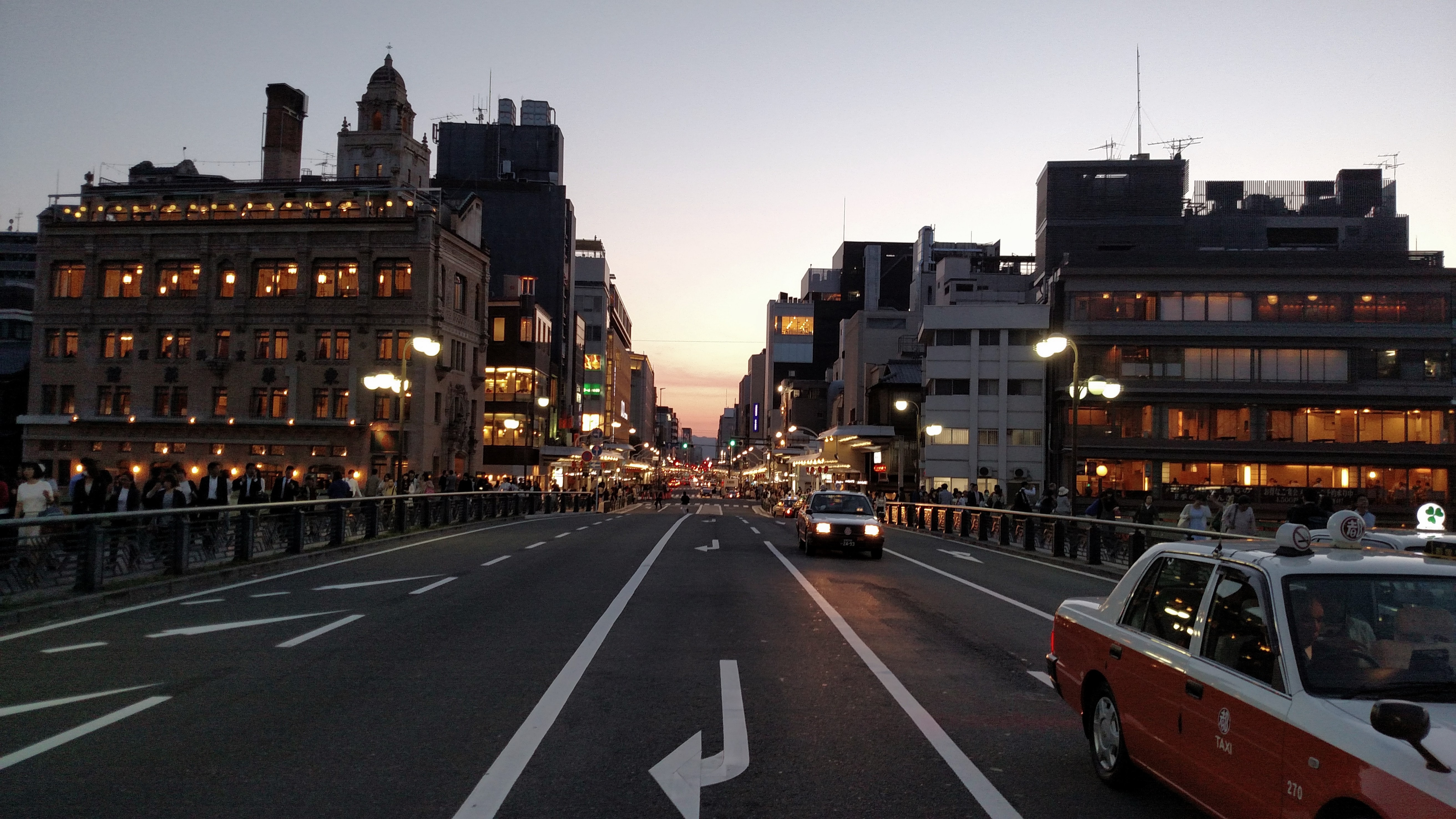 An asphalt road in Kyoto on an evening