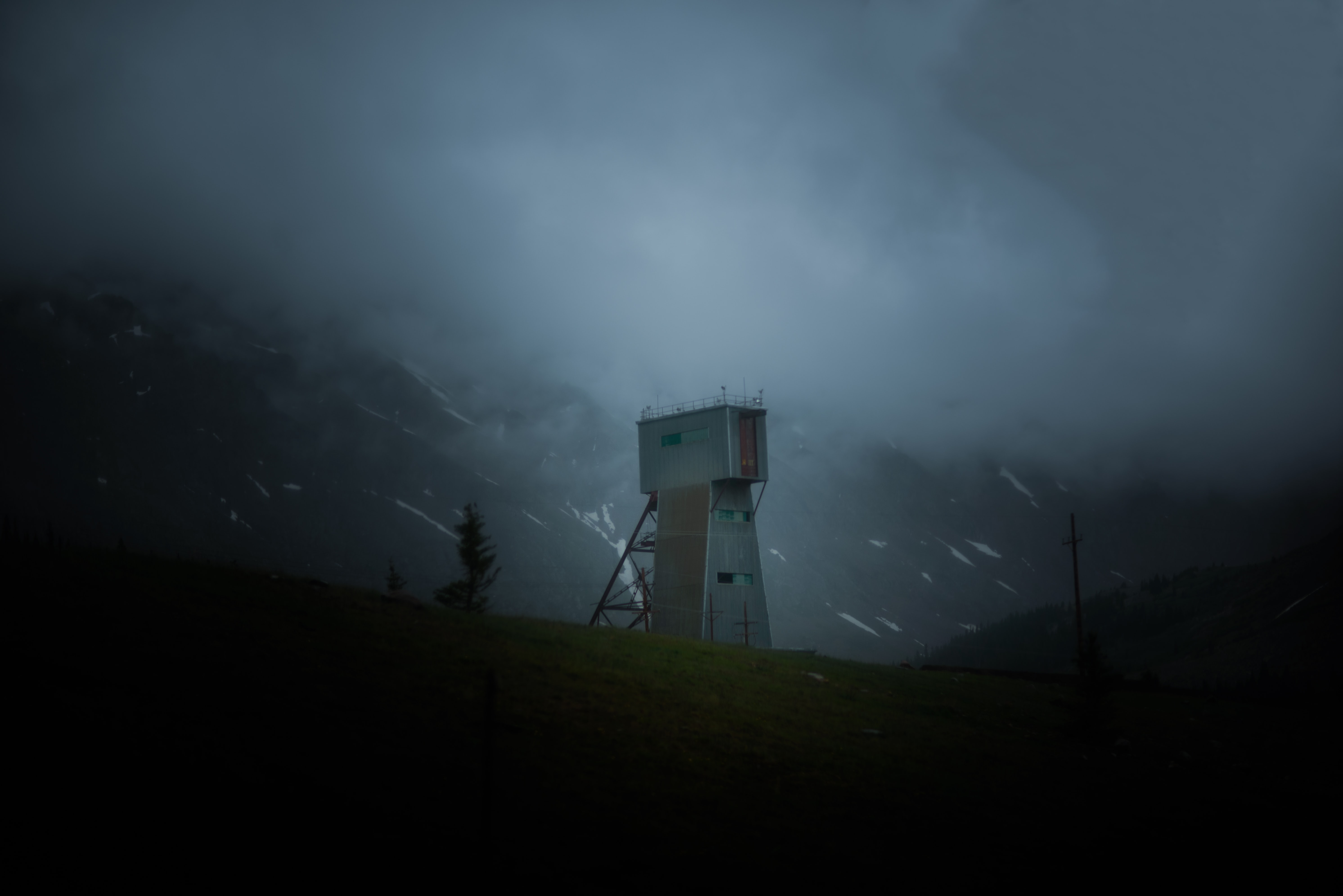 Desolate lookout tower in rocky mountainside on a stormy night