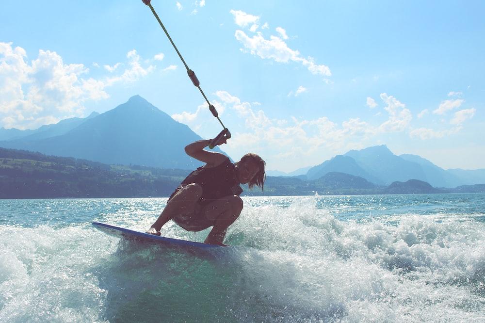 man riding surfboard