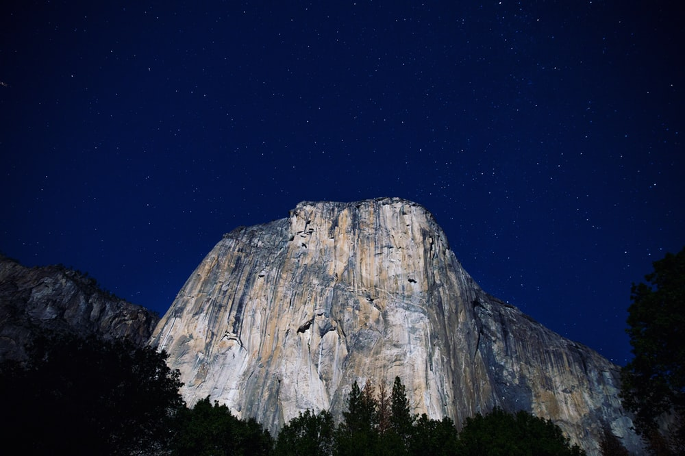 lowangle photography of gray mountains at nighttime
