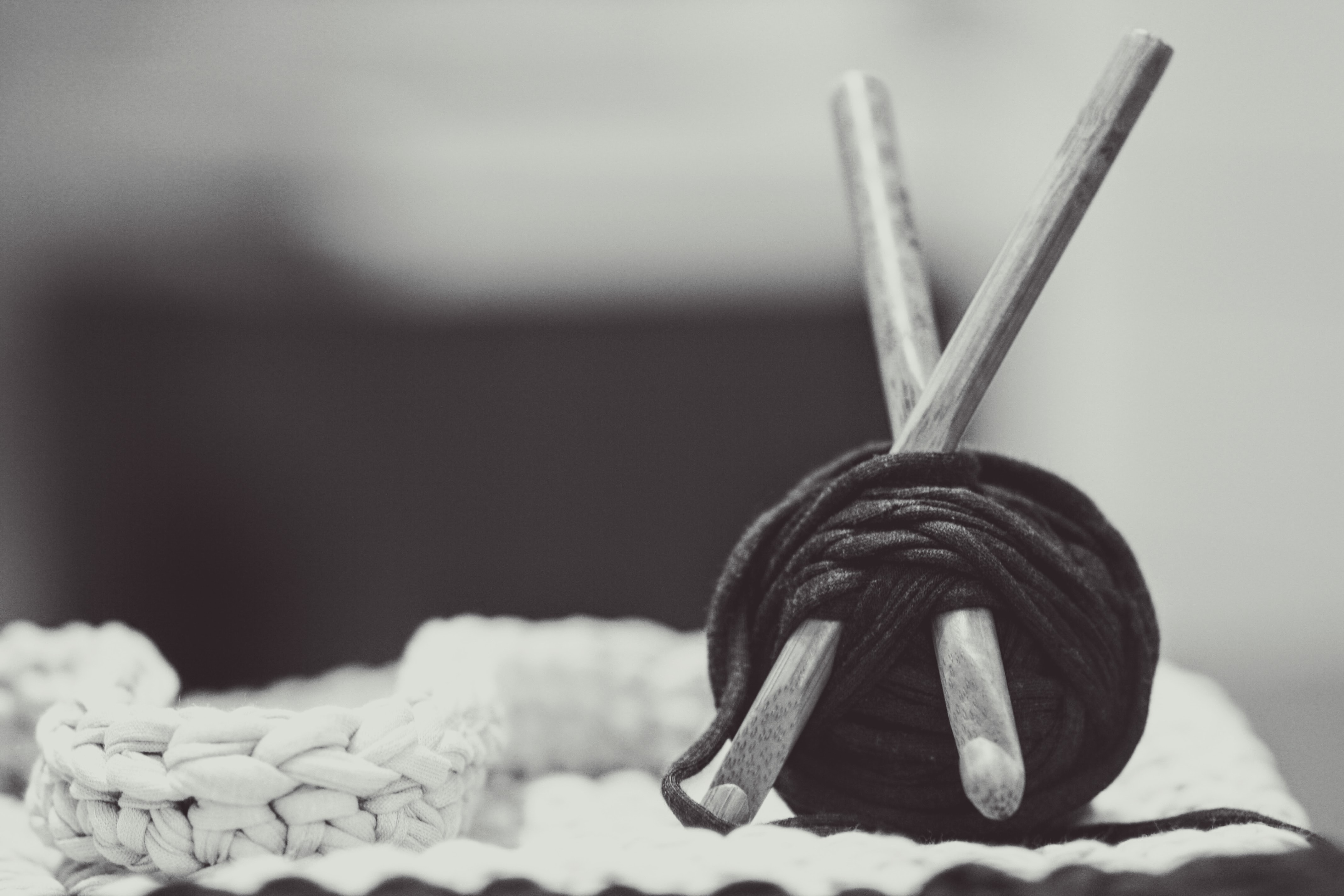 A black-and-white shot of yarn wrapped around crocheting hooks