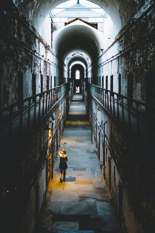 woman in black dress walking inside room