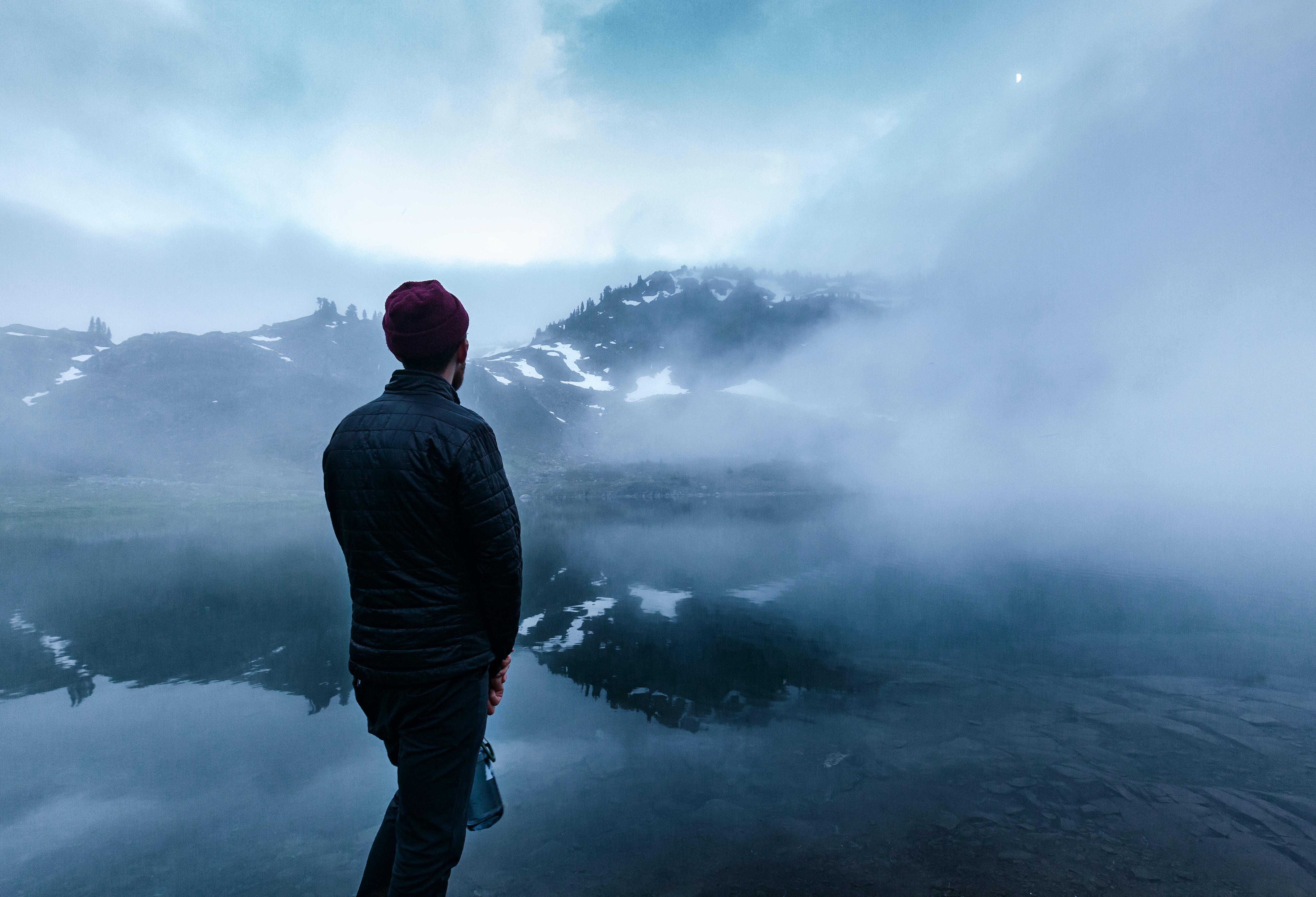 man standing near body of water