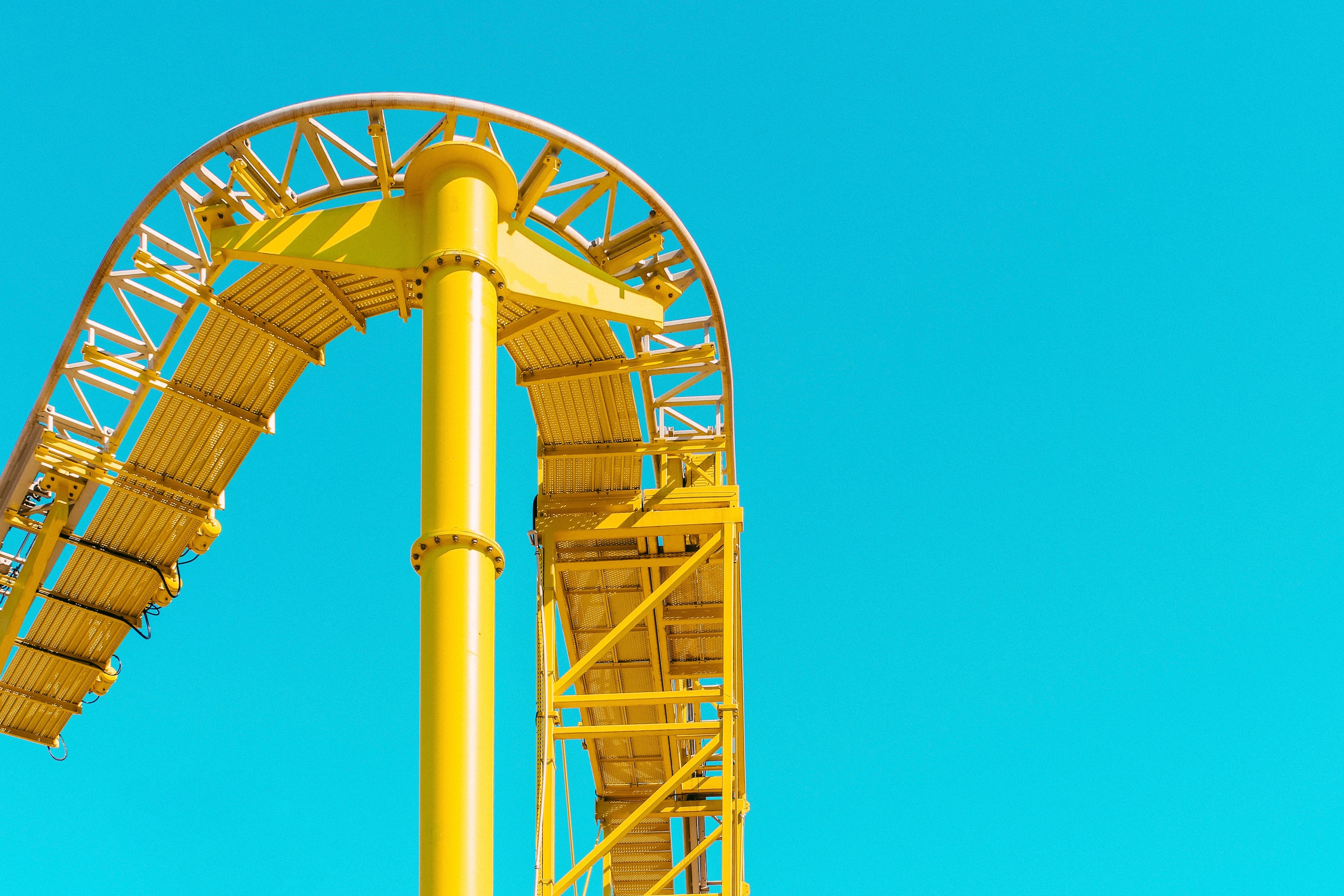 yellow roller coaster rail under clear sky