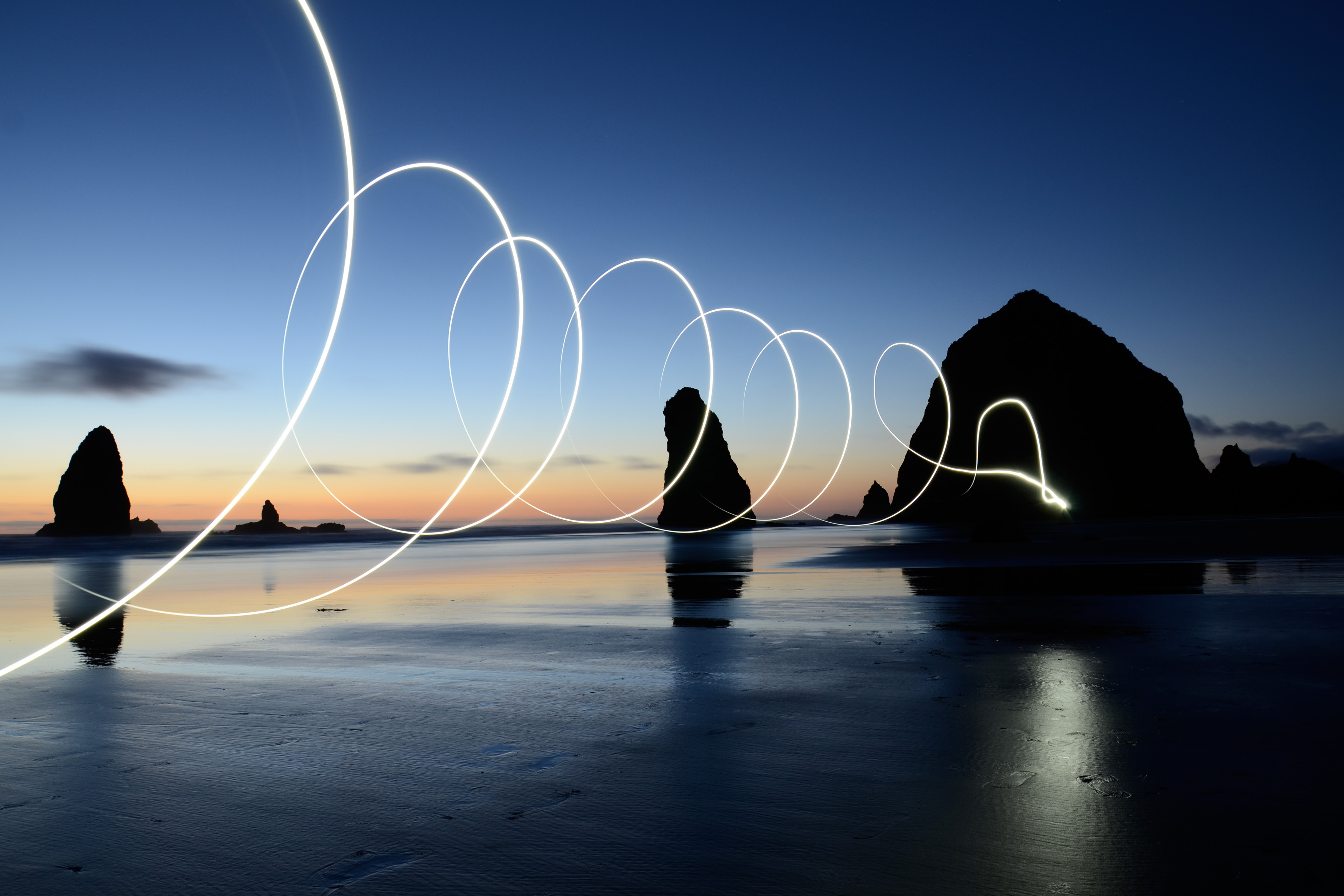 A light painting shot captured with long exposure in Cannon Beach