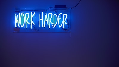 blue work harder neon signage blue zoom background