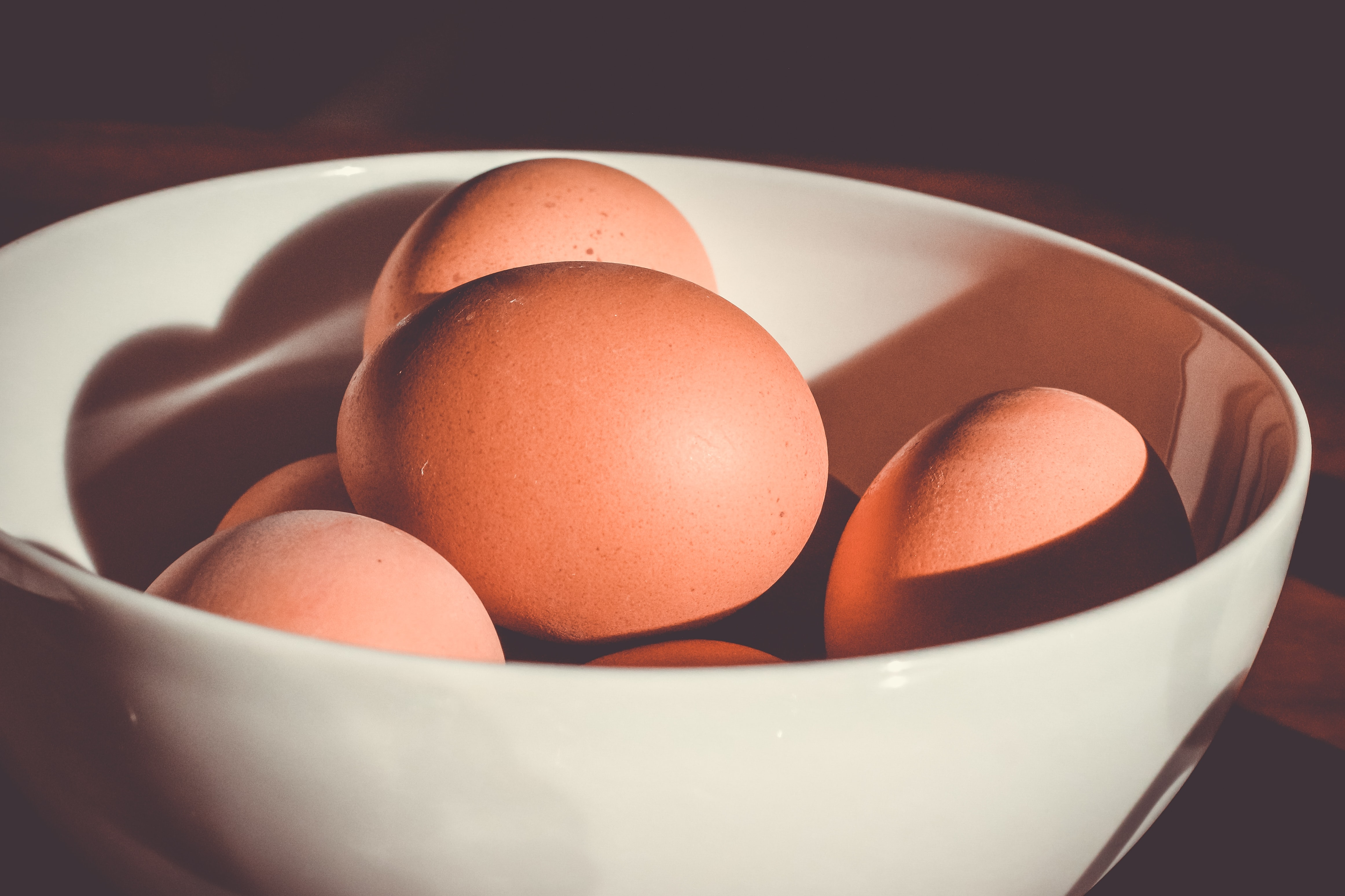 raw eggs on bowl