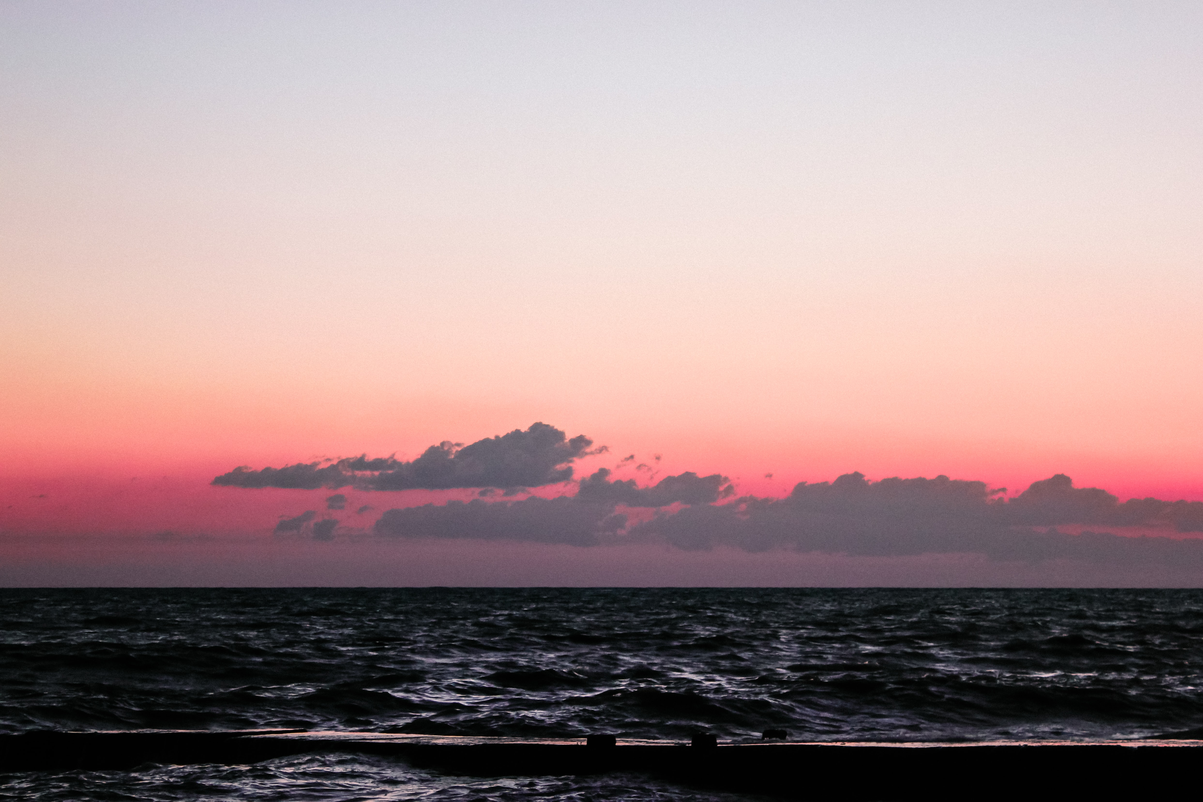Seascape view from Adler, with red, cloudy sky that becomes clear and pale
