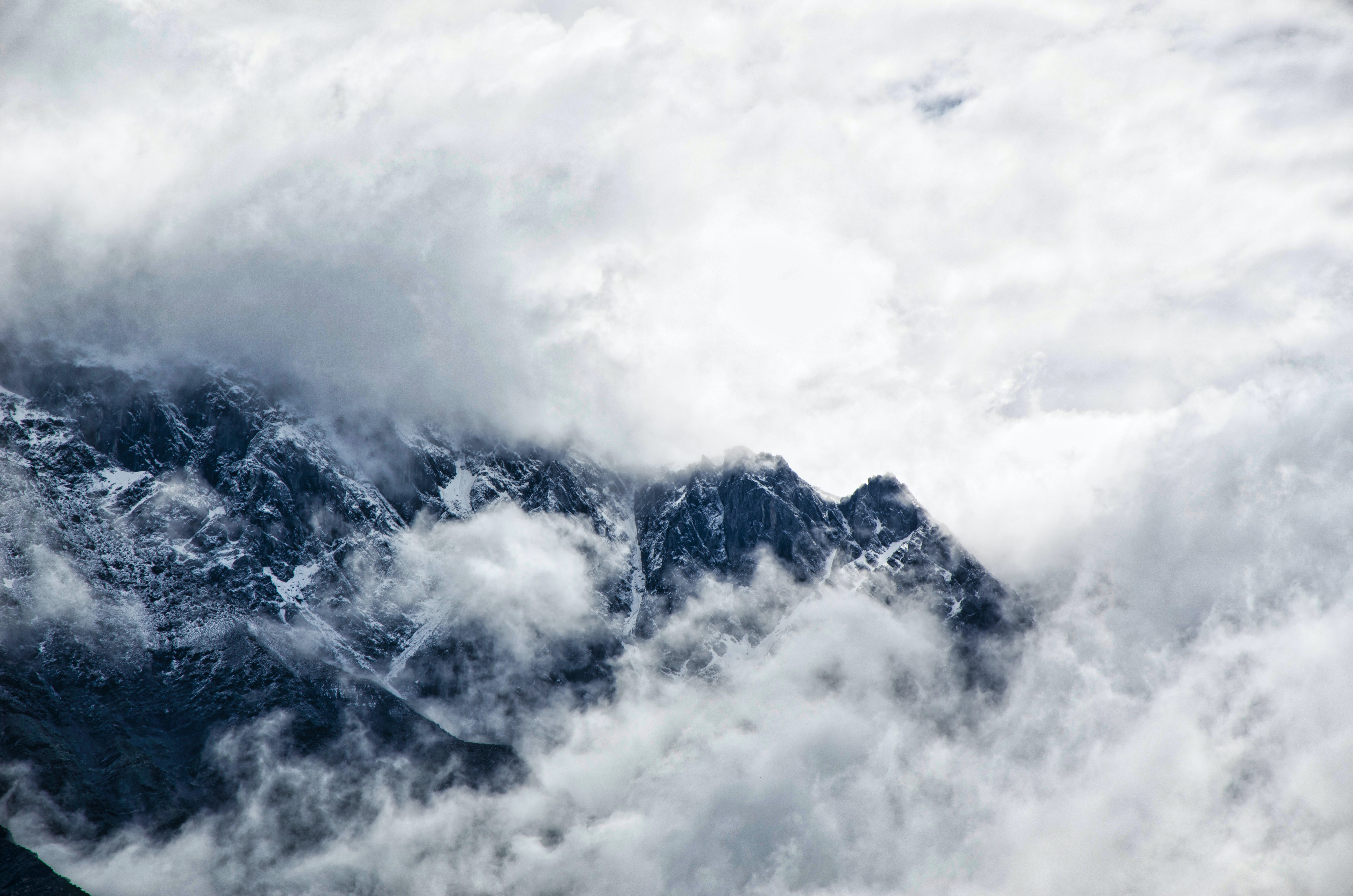 Cold clouds cover Caucasus Mountains on a foggy winter day
