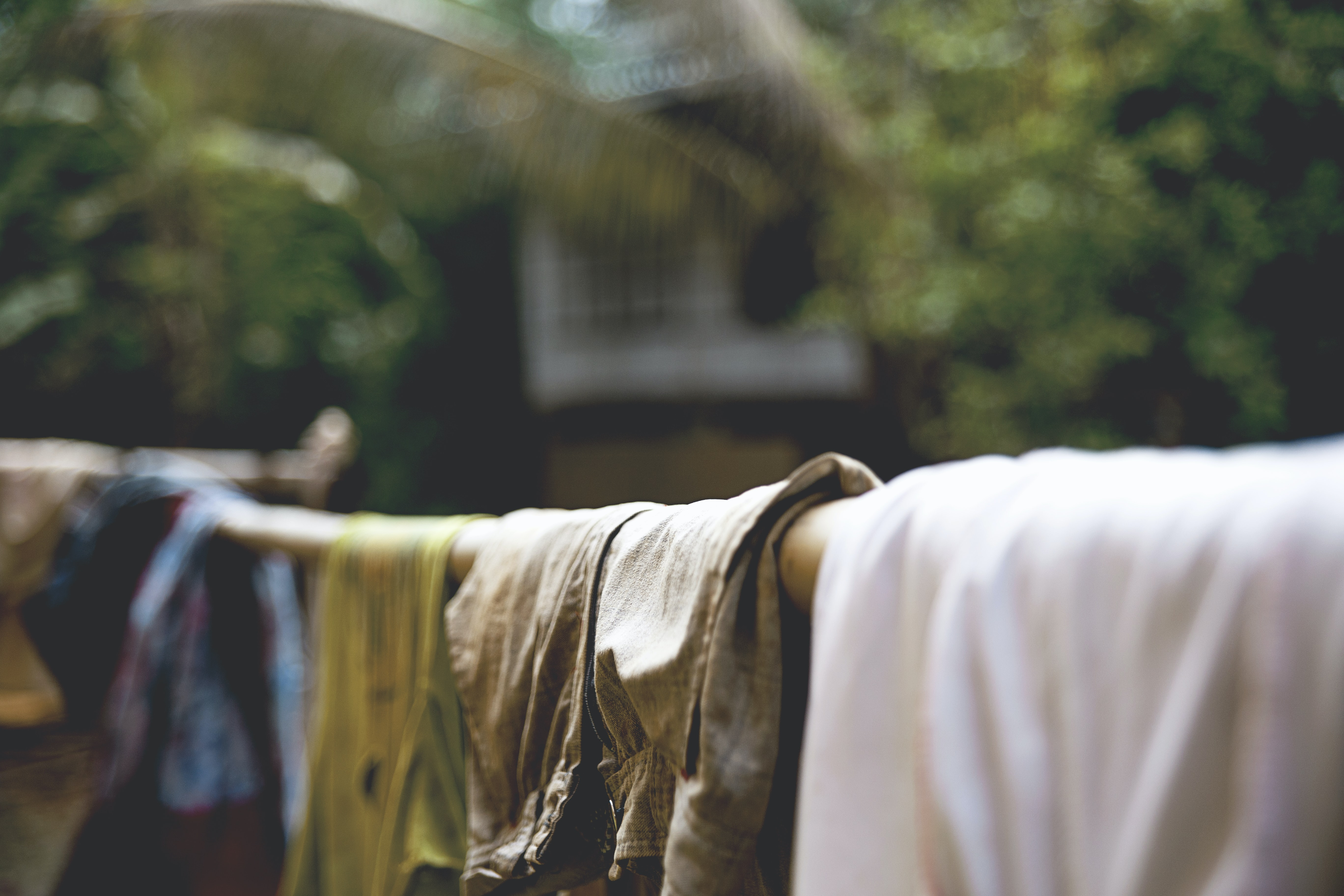 Clothing drying on a bamboo pole in front of a building at Noh Bo Academy