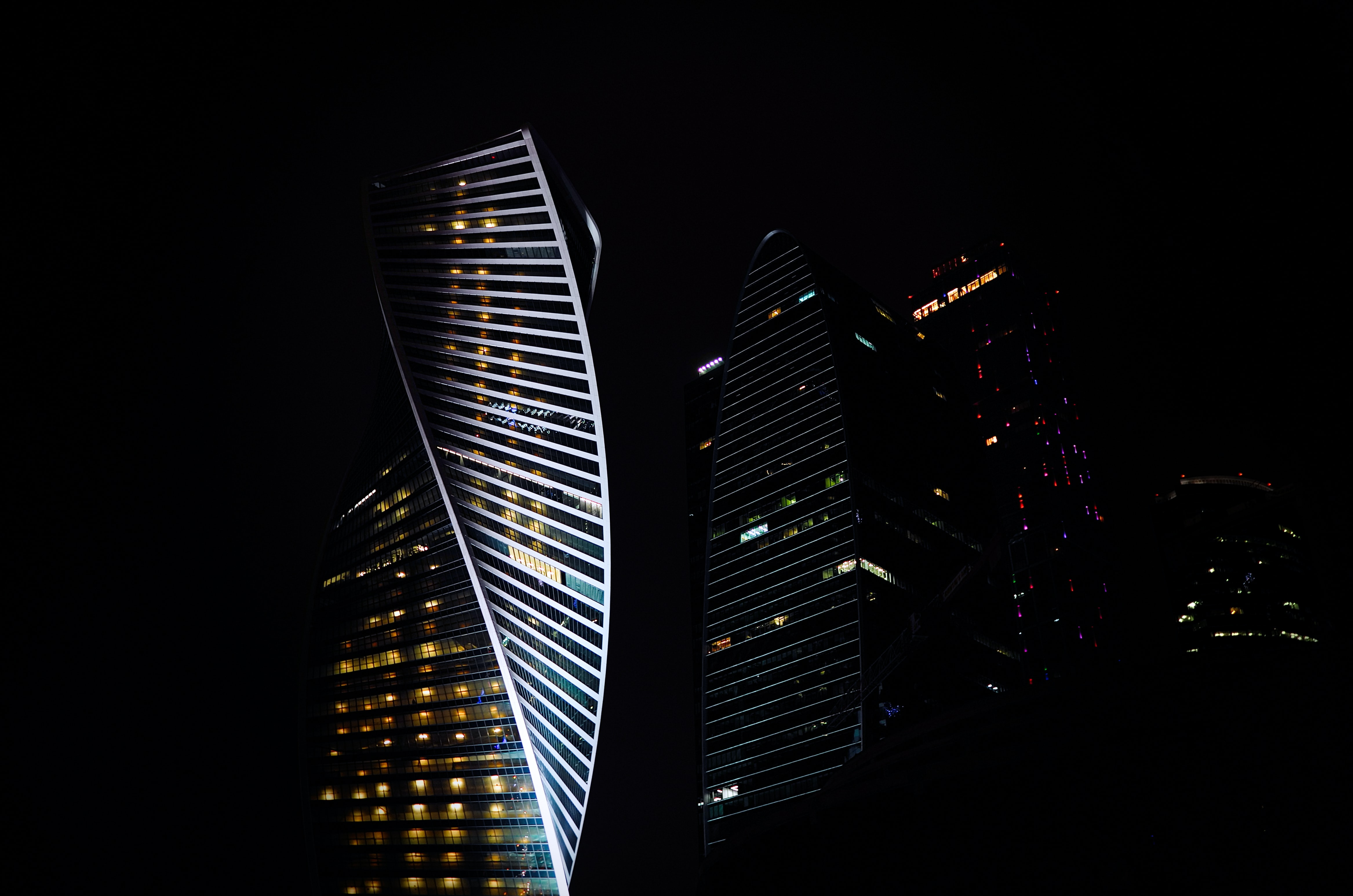 Twisting façades of office buildings in Moscow at night