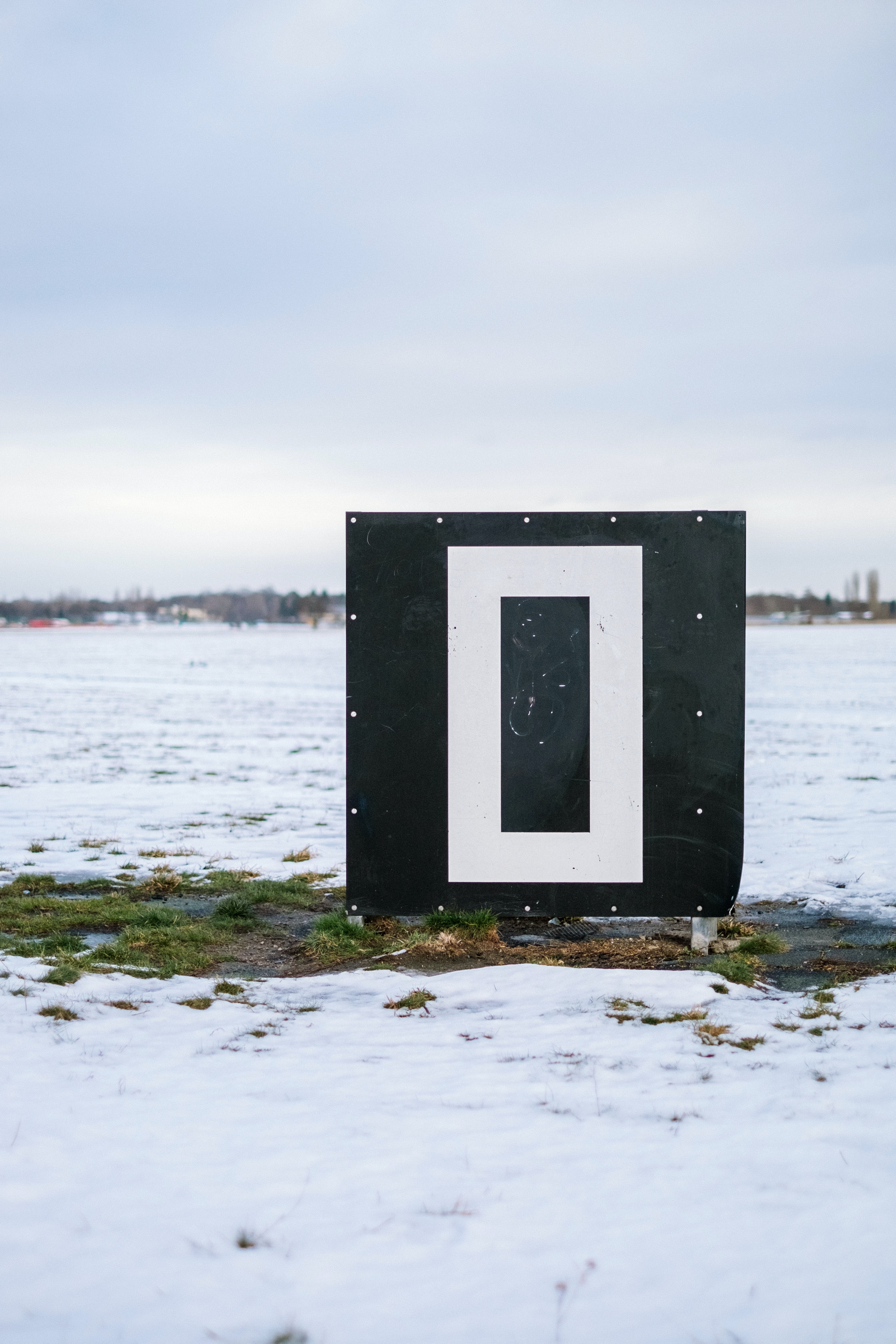 A small building surrounded by snow at the Germany airport runway, Berlin Tempelhofer Airport
